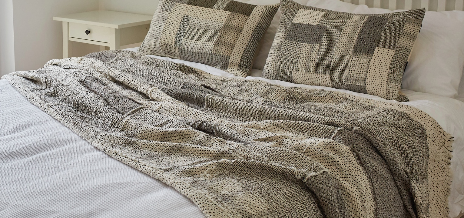 The Raw Chindi Quilt, inspired by Japanese Boro fabrics,is made from a patchwork of kala cotton fabrics, sewn with the raw edges on the surface