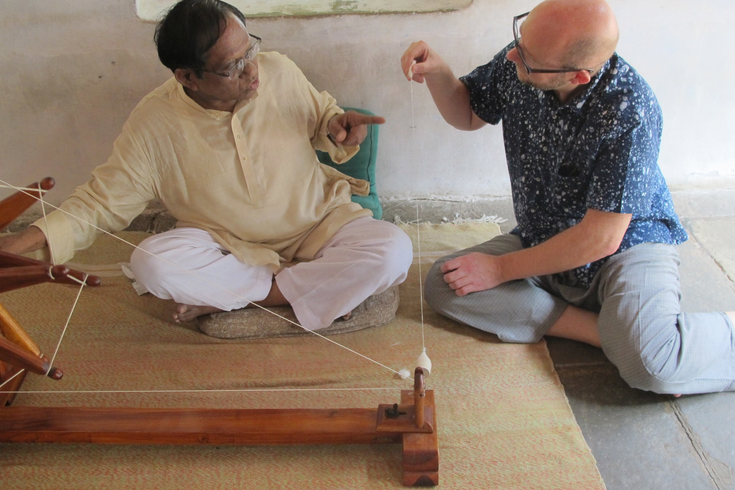 Graham learning to hand-spin at the Gandhi Ashram in Ahmedabad