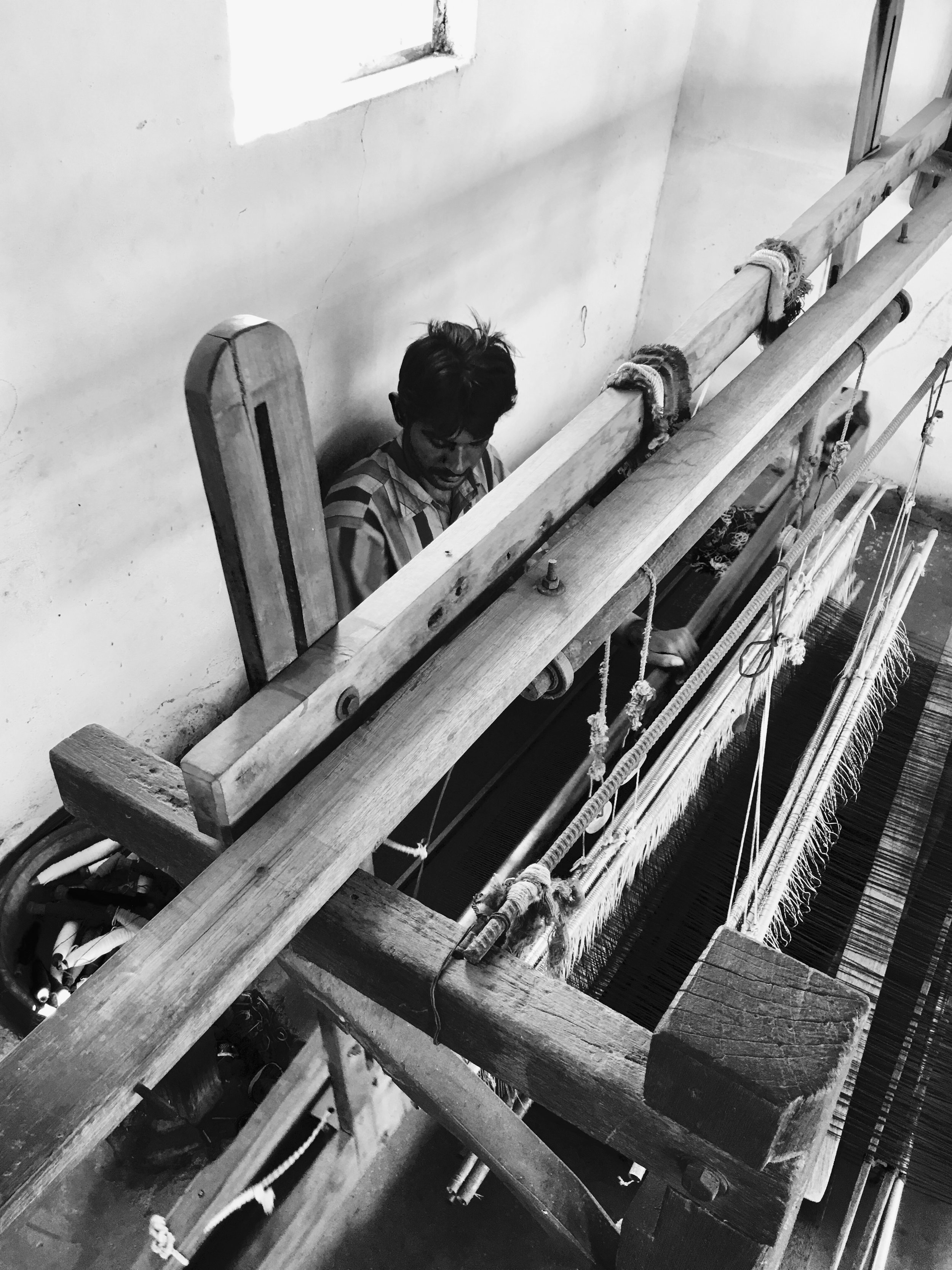 Kala Cotton Weaver on a traditional pit loom in Kutch
