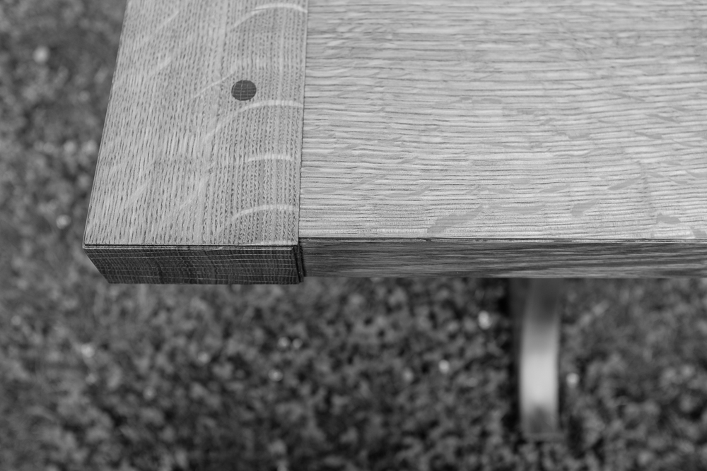 Breadboard end. Draw-pegged mortise and tenon joinery holds them in place.