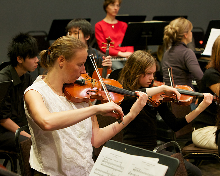 Andrea Siradze  performs alongside students during one of our Side by Side concerts.