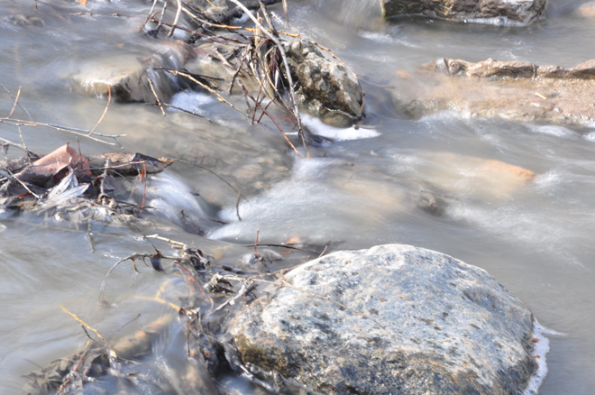 """I included this one because I am very proud of it. It's my first ever attempt at capturing flowing water against a (semi) sharp background with the """"big"""" camera and though it's overexposed, I am  thrilled  at the softness of the water against those rocks. I can't wait to try it again - next time with a tripod!"""