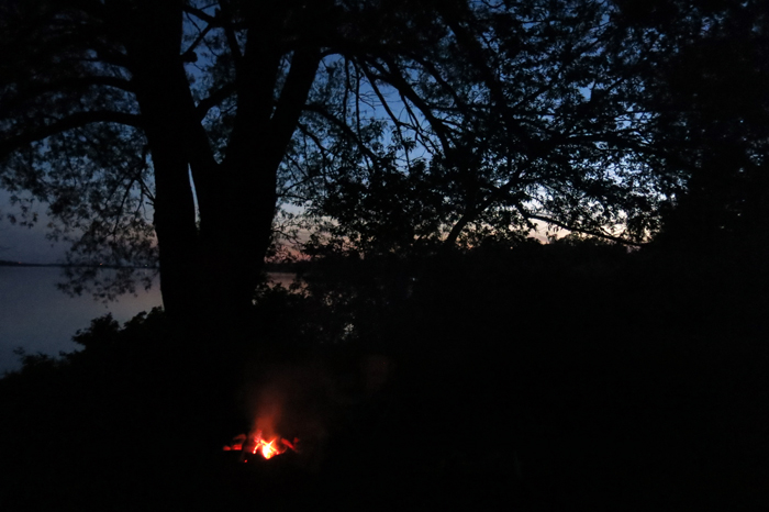 Campfire by the St. Lawrence river this past weekend. That night, the night of the full Strawberry Moon, D. and I heard coyotes call each other across the river.