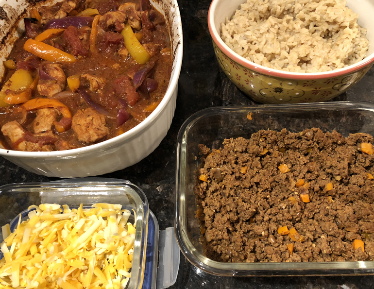 Meal prep allows me to try new recipes AND helps me get my workouts in. From top left, clockwise: baked chicken fajita mix, brown rice, taco beef mix, shredded cheddar.