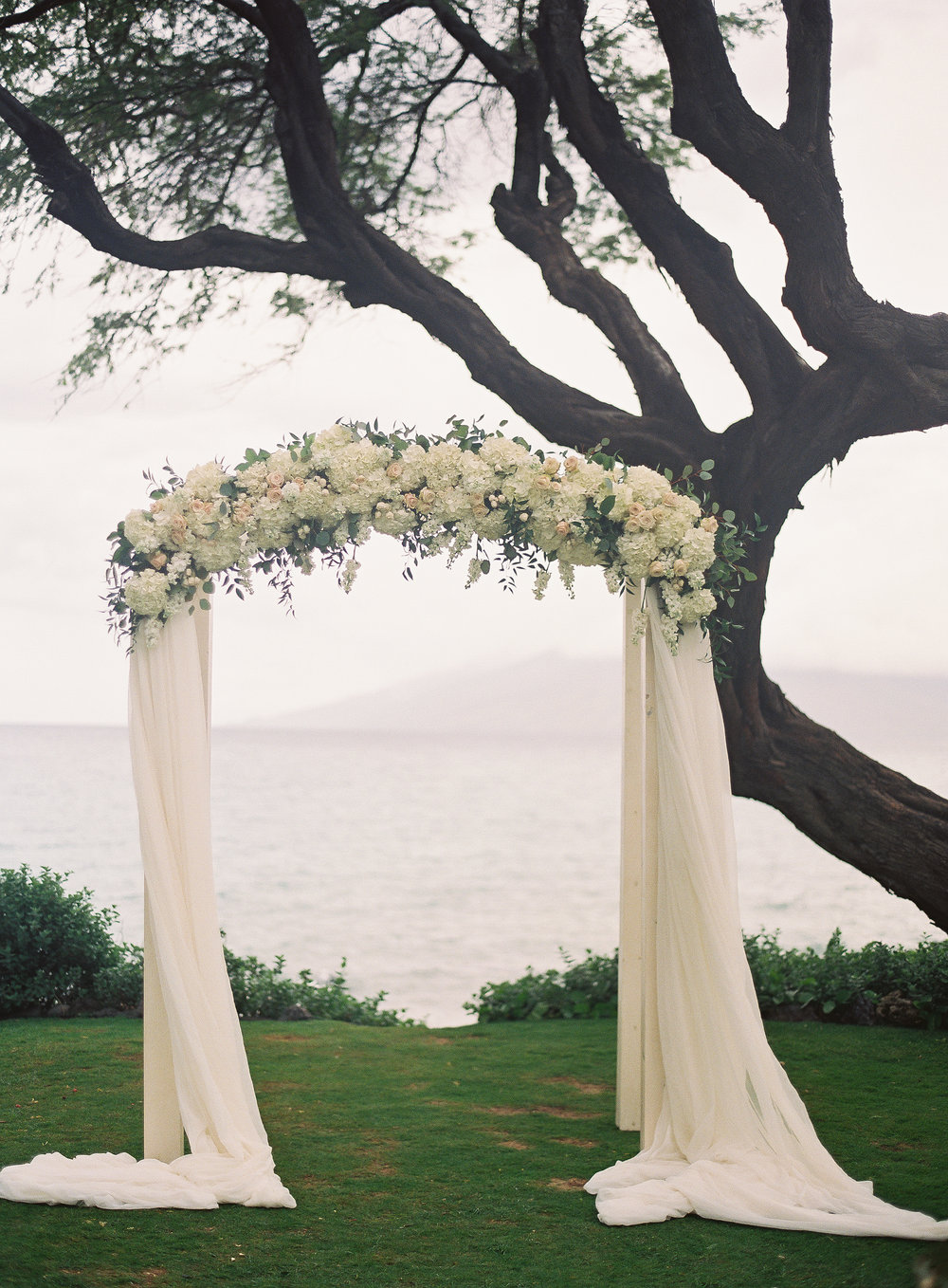 Ivory Curved Wedding Arch — Signature Boutique Event Rentals Maui, Hawaii
