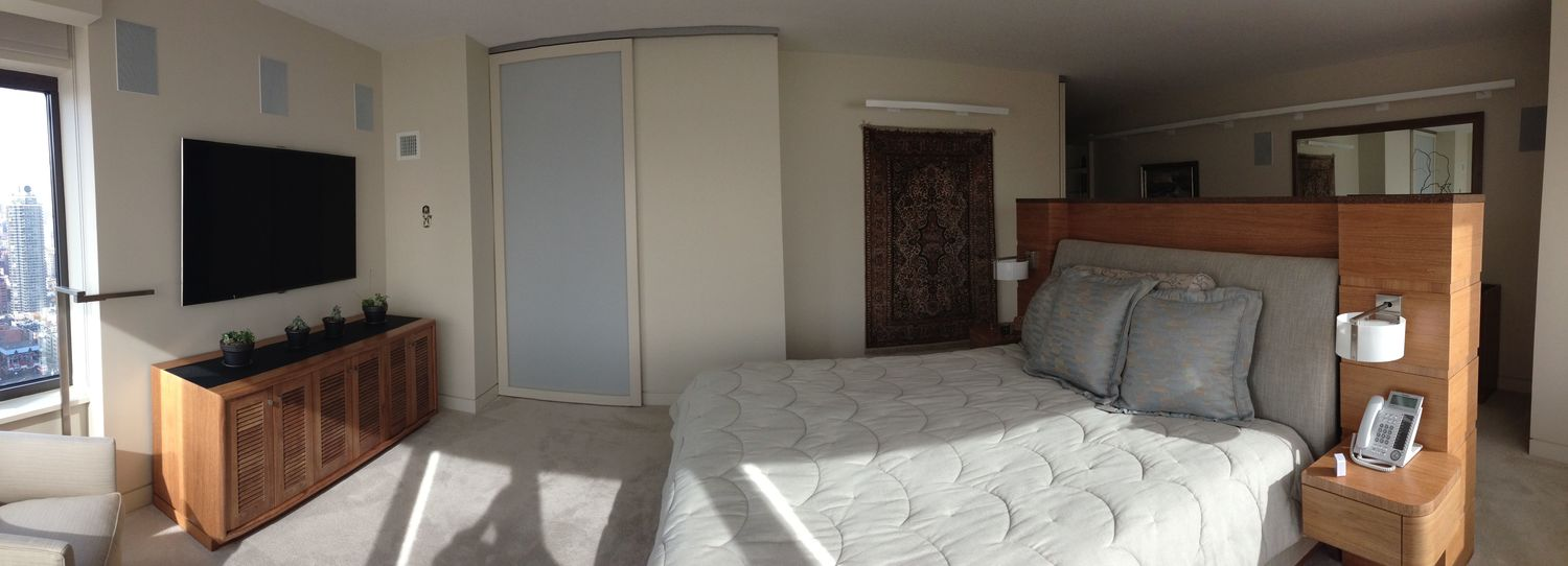 """The bedroom has a huge 70"""" TV because it is located so far from the bed."""