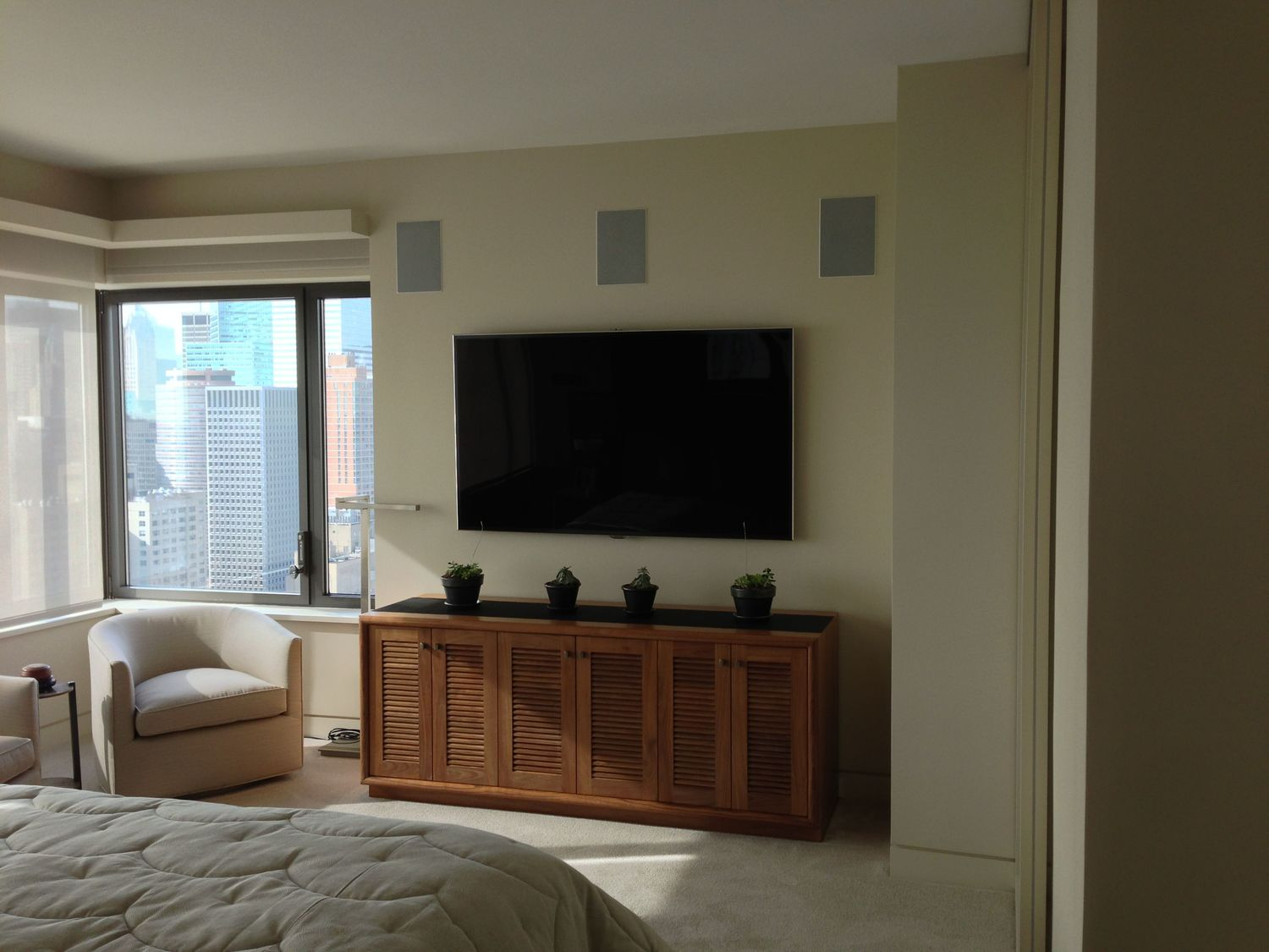 """This is another view of the 70"""" TV from the perspective of the bed where it will be watched."""