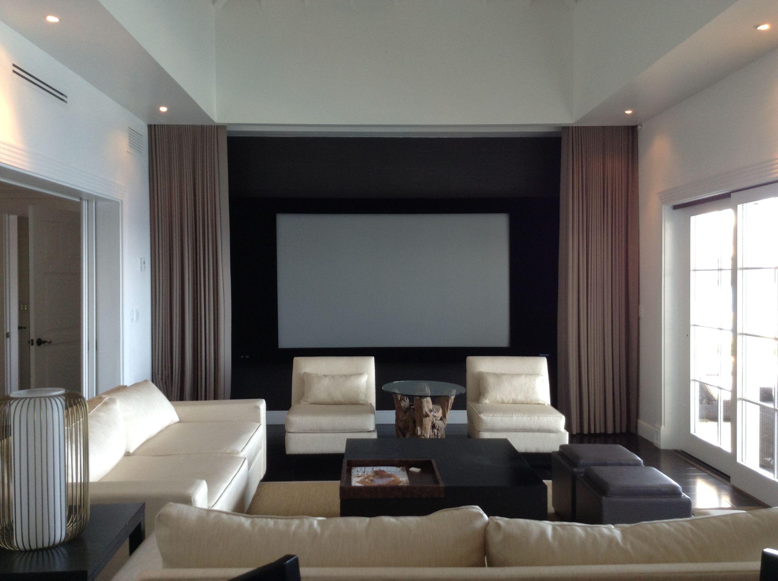 This is the best movie theater in the Caribbean. The living room features a 7.2 JBL Synthesis system, curved automasking projection screen, and 3D projector. When the projector turns on, the curtains in front of the screen open and the blinds roll down to shut out the Caribbean sun.