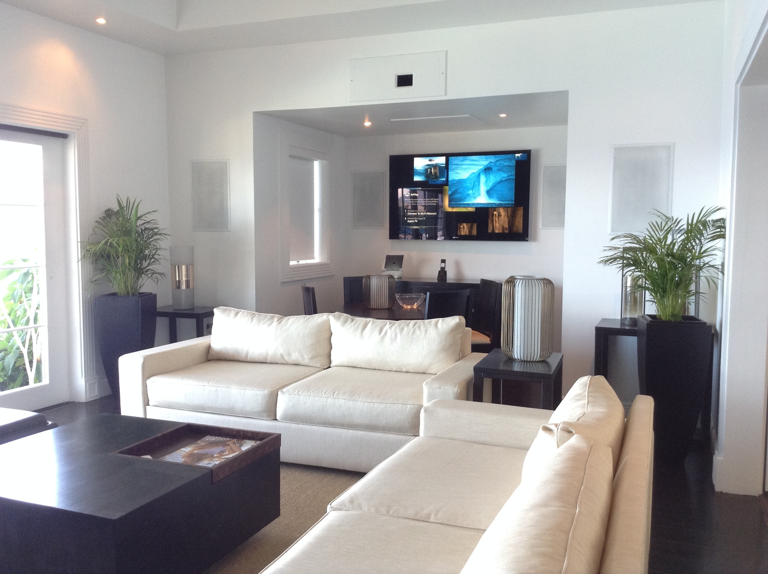"""On the opposite side of the room is a 60"""" LED TV, for watching high-motion content, like sports, during the day."""