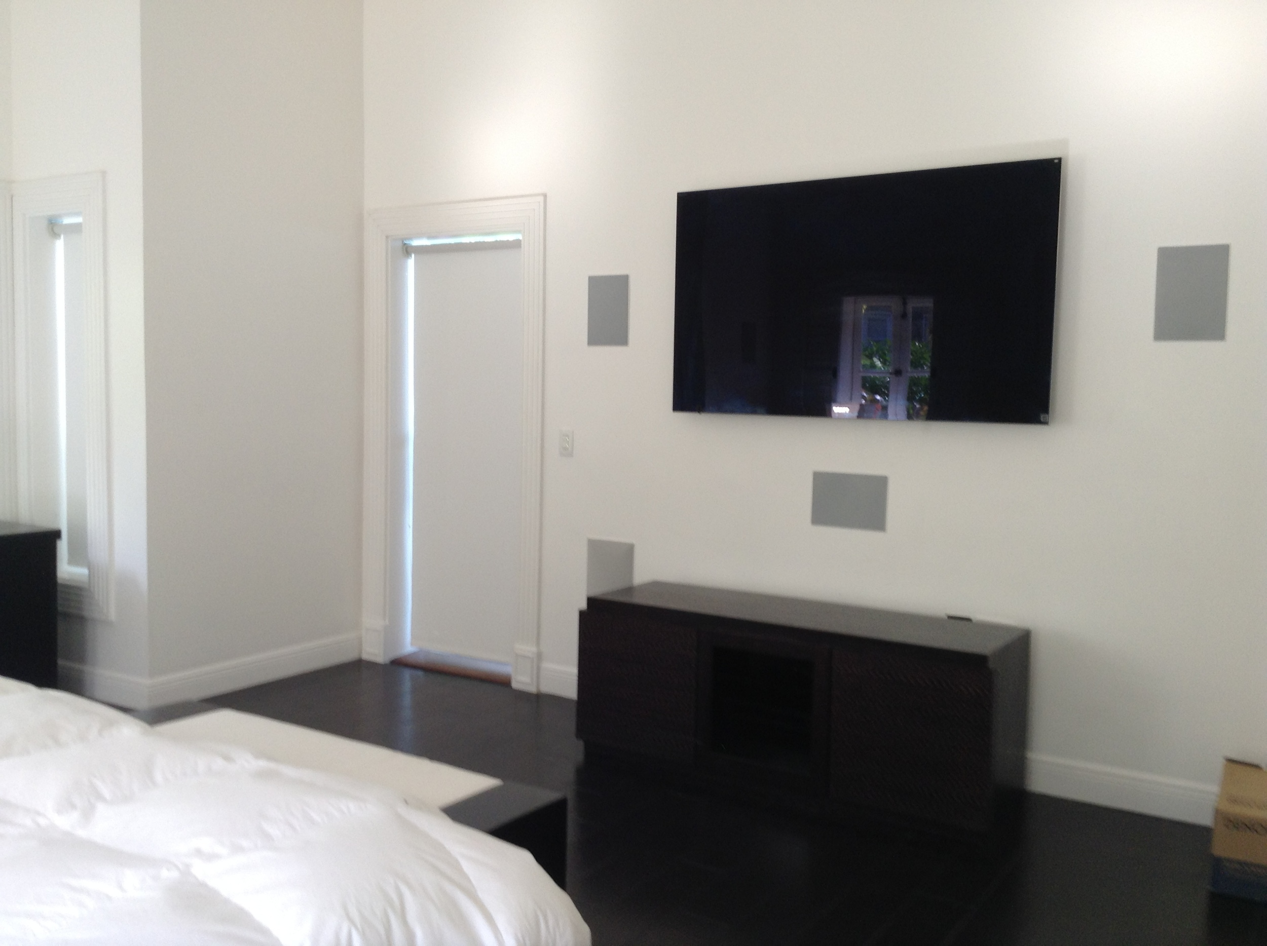 Every bedroom in the house features a single smart remote control to turn everything on and off. This bedroom in particular has 5.1 surround sound speakers.
