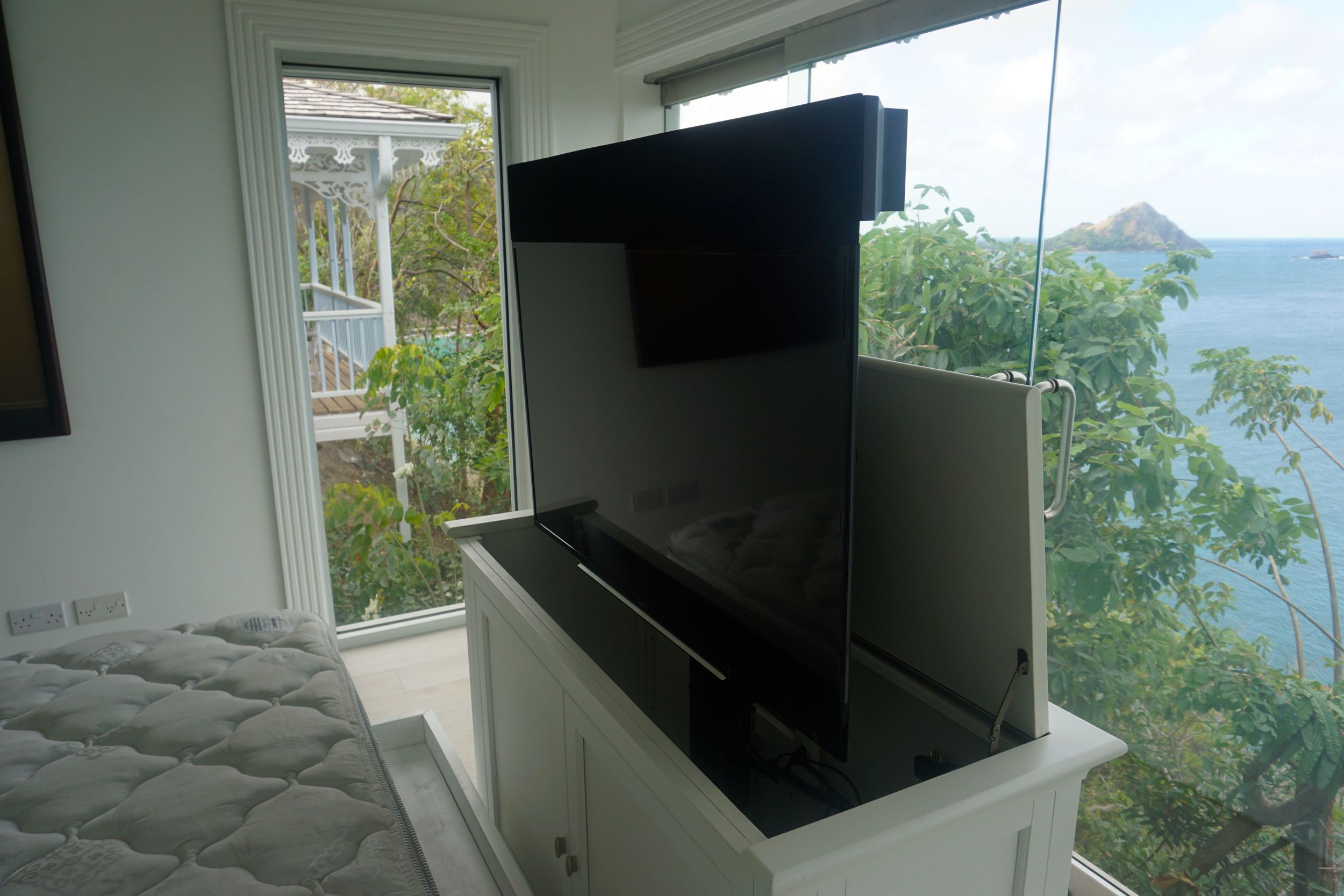 Another TV pops out of a cabinet in the bedroom.