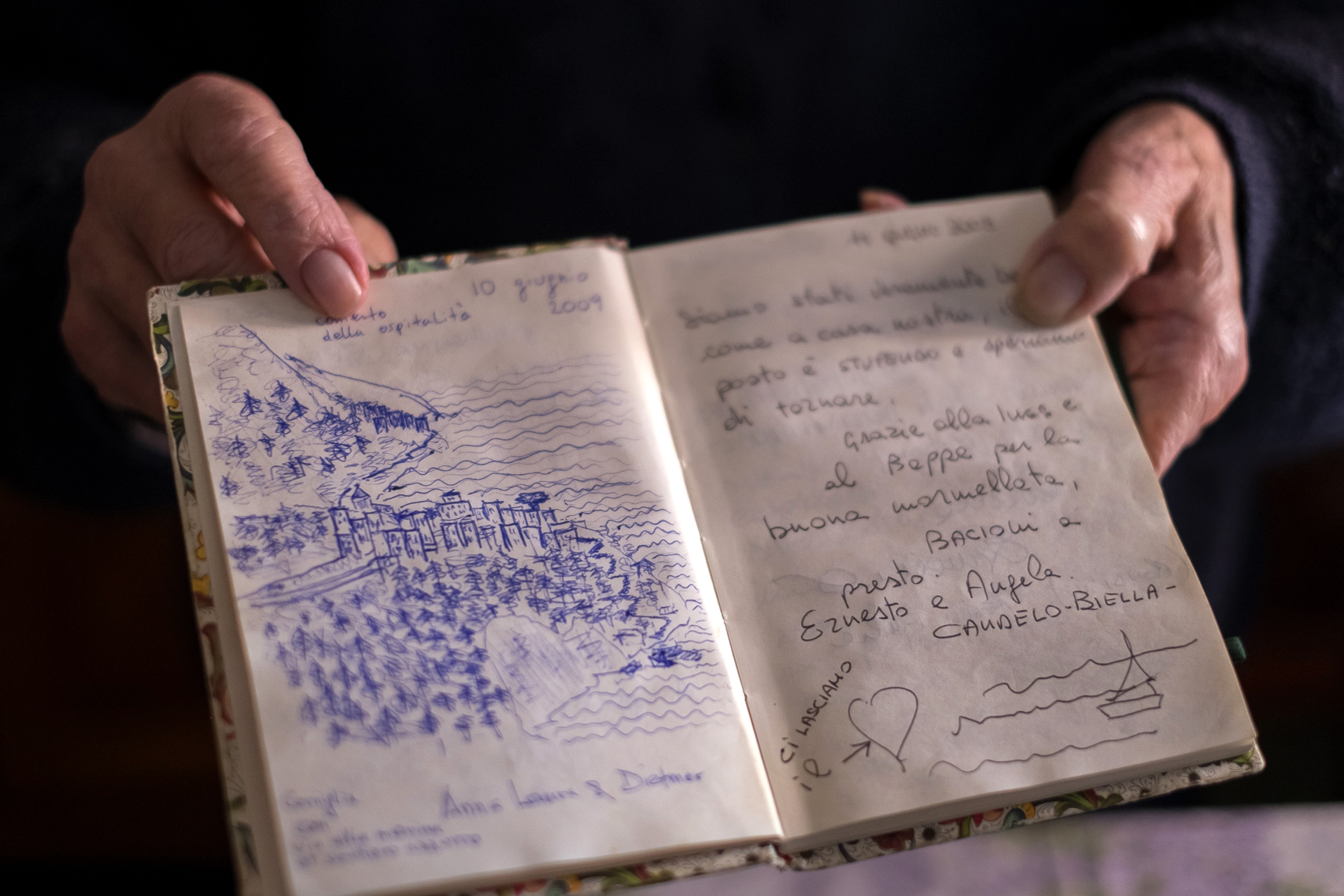 Ines shares her guestbook with us filled with notes and drawings left by guests since starting the B&B in 2000.