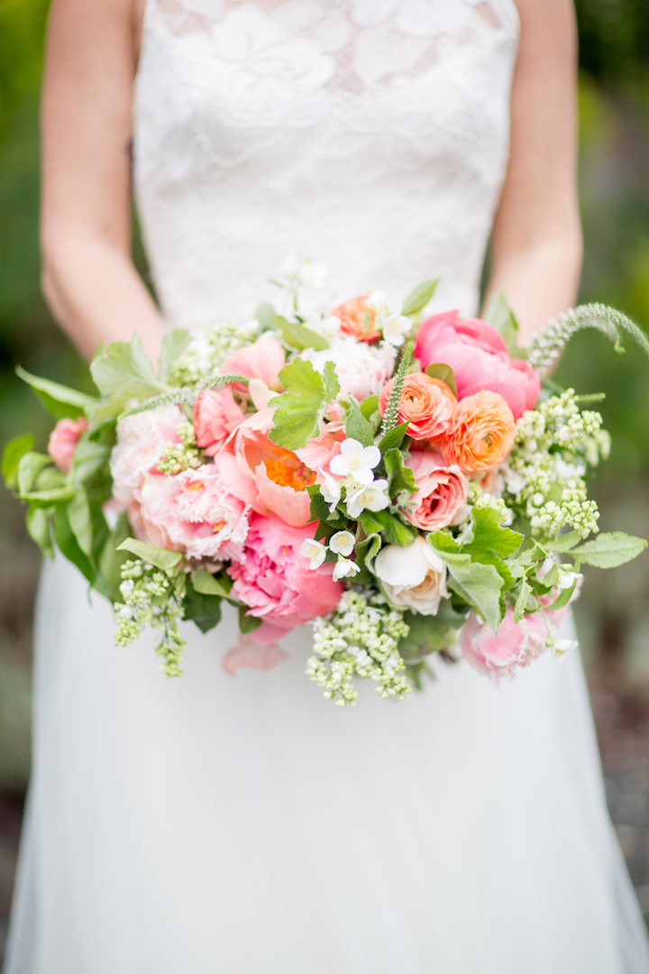 A beautiful bride holding a bouquet by my favorite floral designer,  Revel Floral.