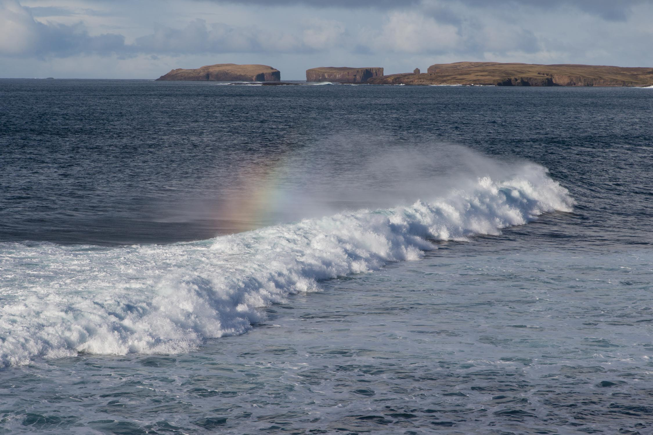 Photograph taken from Sandness, Shetland looking out towards the Sound of Papa with the island of Papa Stour in the distance.