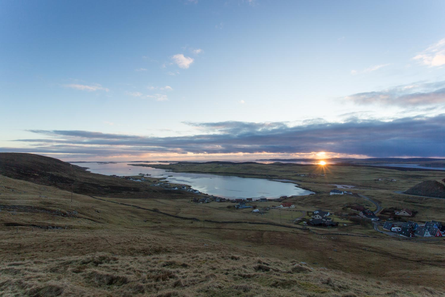 Sunset from the top of Wormadale looking out Whiteness Voe.