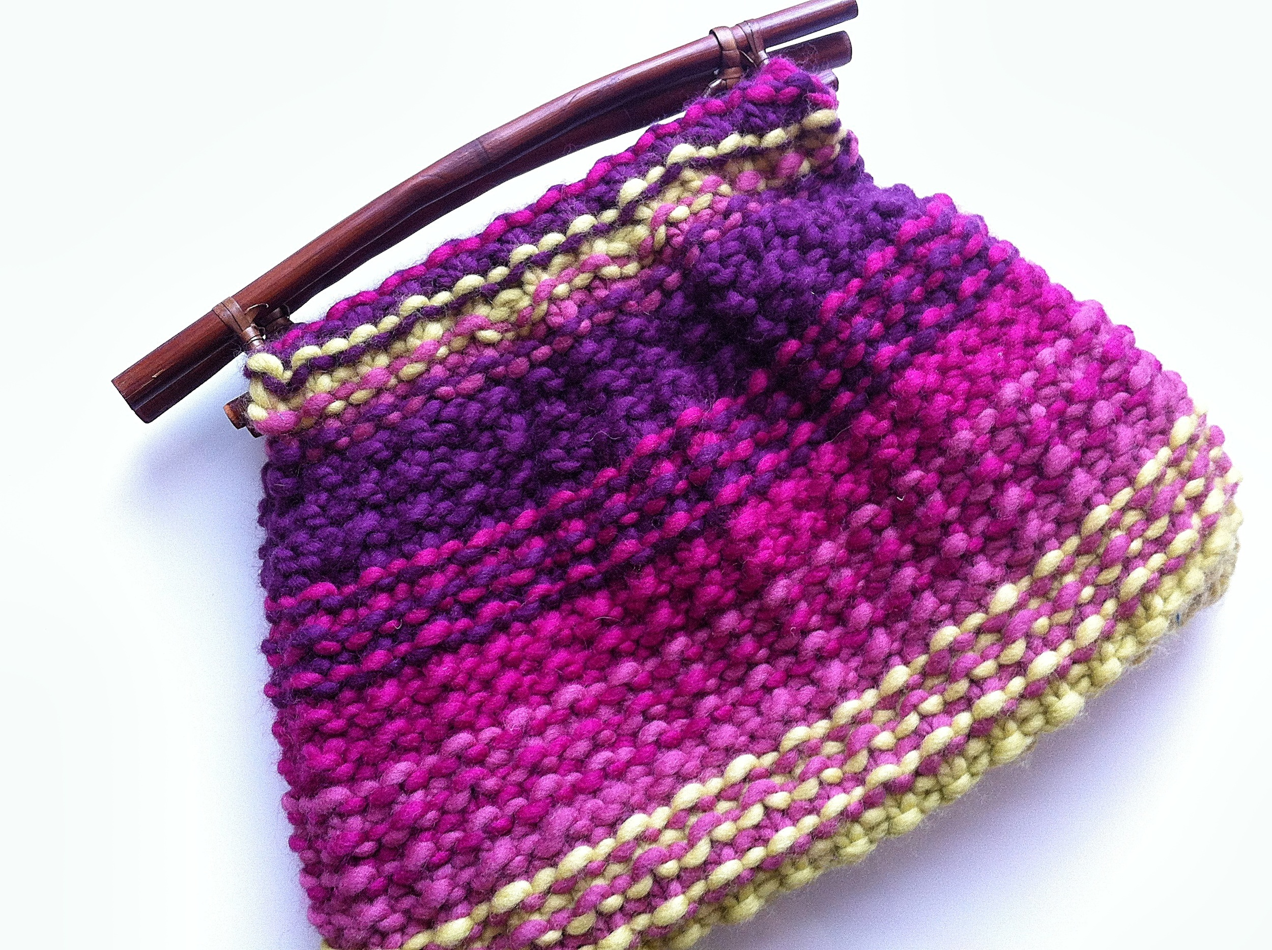 Pattern:    Knitting Bag    by Debbie Bliss Yarn: Debbie Bliss Como in 19010 (Raspberry), 19021 (Magenta), 19022 (Purple) and 19018 (Yellow/Green) Yardage (for the Pre-Process Stashdown 2013): 160 yards Click the photo to link to my Ravelry project notes