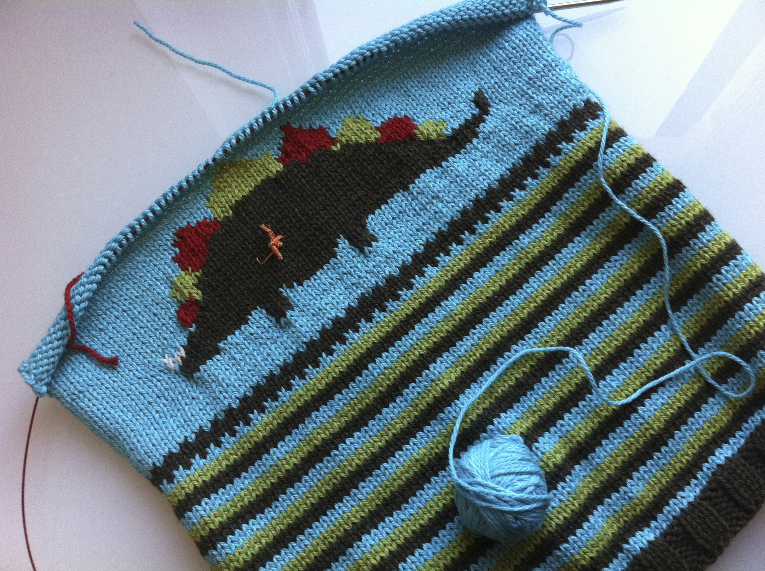 The intarsia dinosaur is now complete and I'm rushing to get the front of the sweater finished so I can move on to the sleeves.