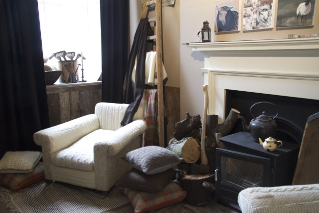 Fireside chair recovered in jumpers.jpg