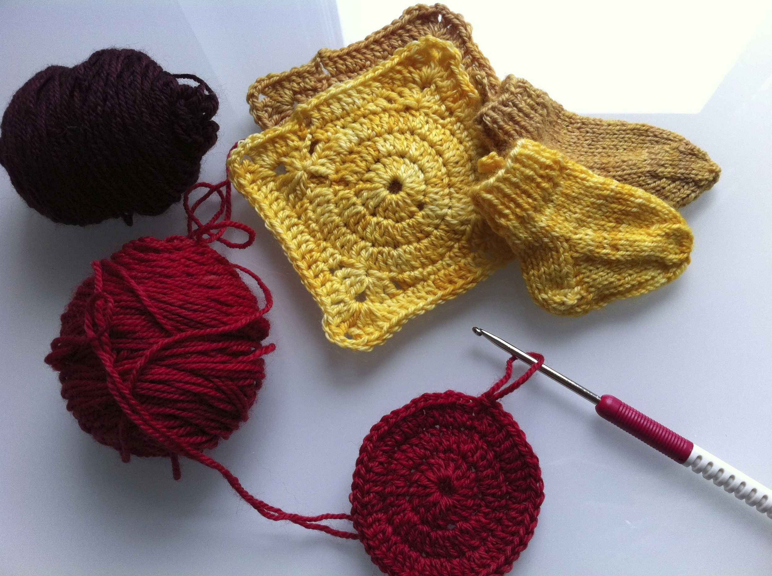 Kate Atherley's  Training Sock  and the crochet motif for  Bear's Rainbow Blanket  from Purl Soho.