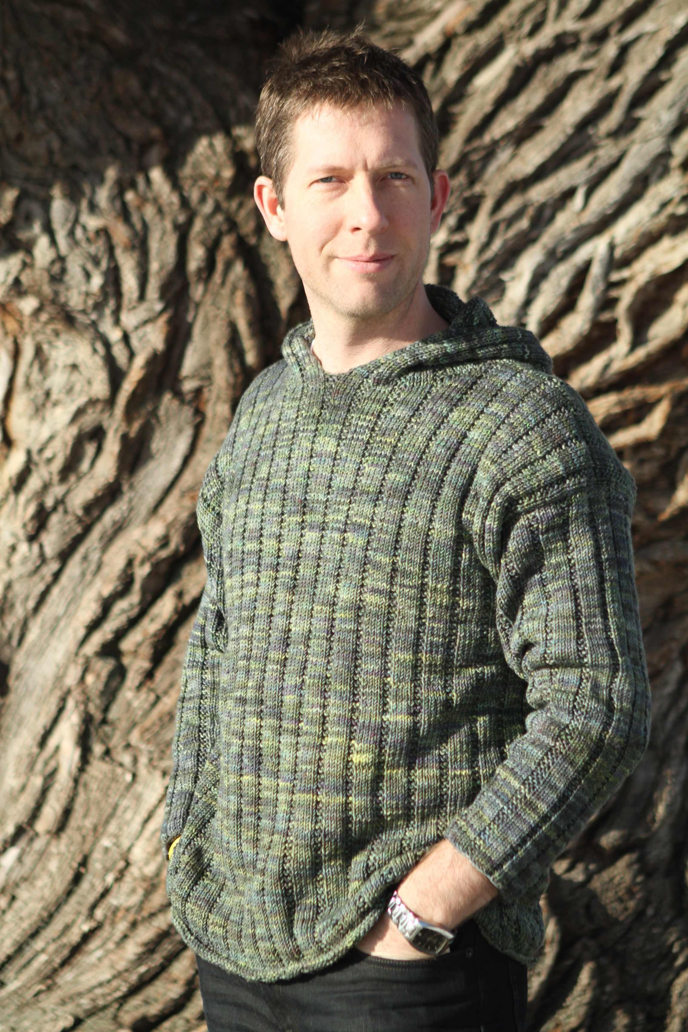 A sweater knit for my DH in a colour that suits him (and the sweater) better than a red ever could.