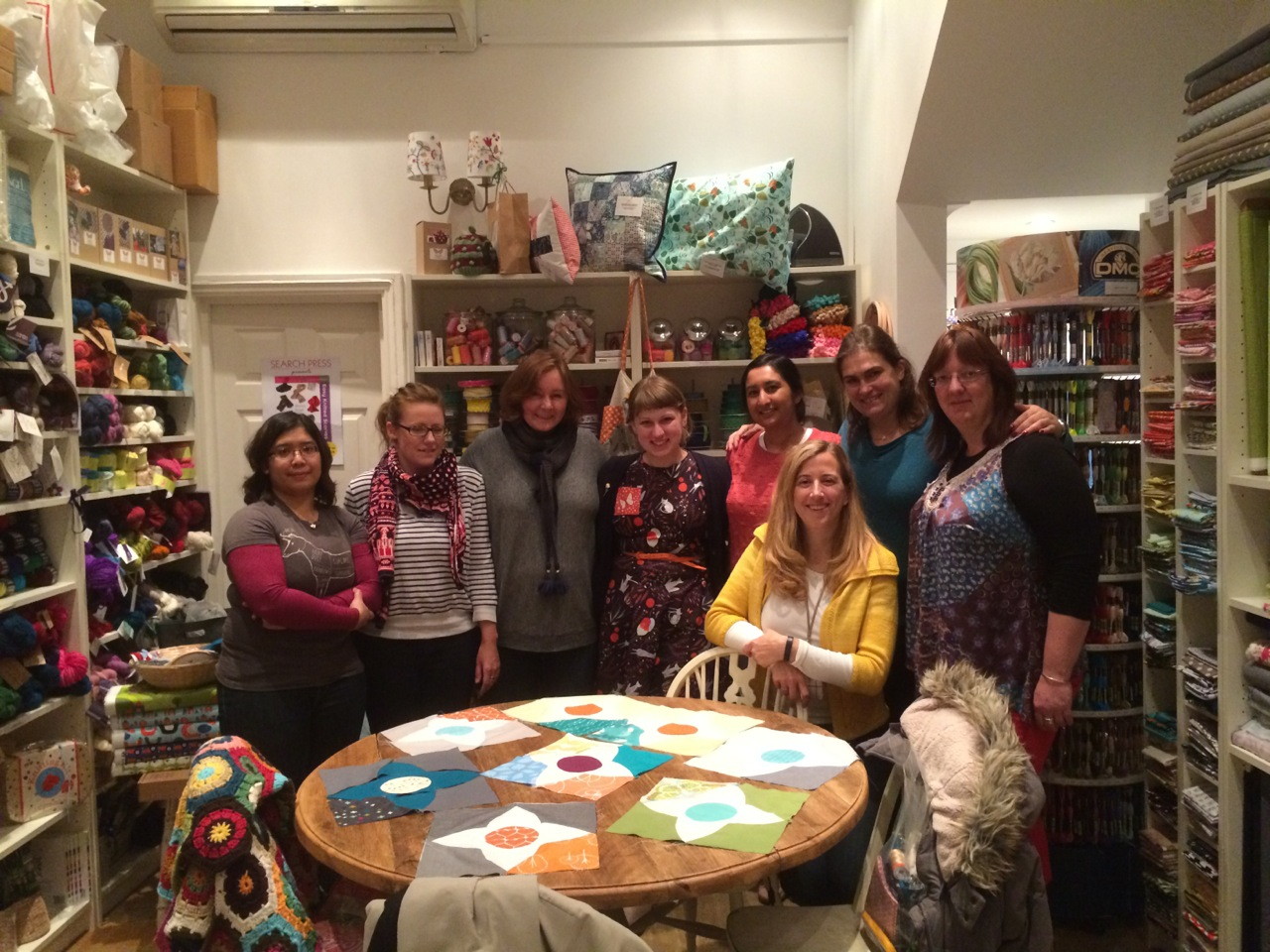 The afternoon session of Lizzy's Meadow Quilt class shows off their first blocks.