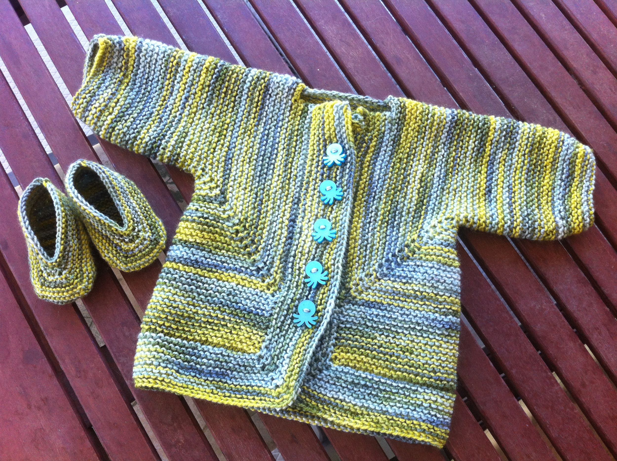 The Baby Surprise Jacket and booties I knit for Mr. Russell this past summer.