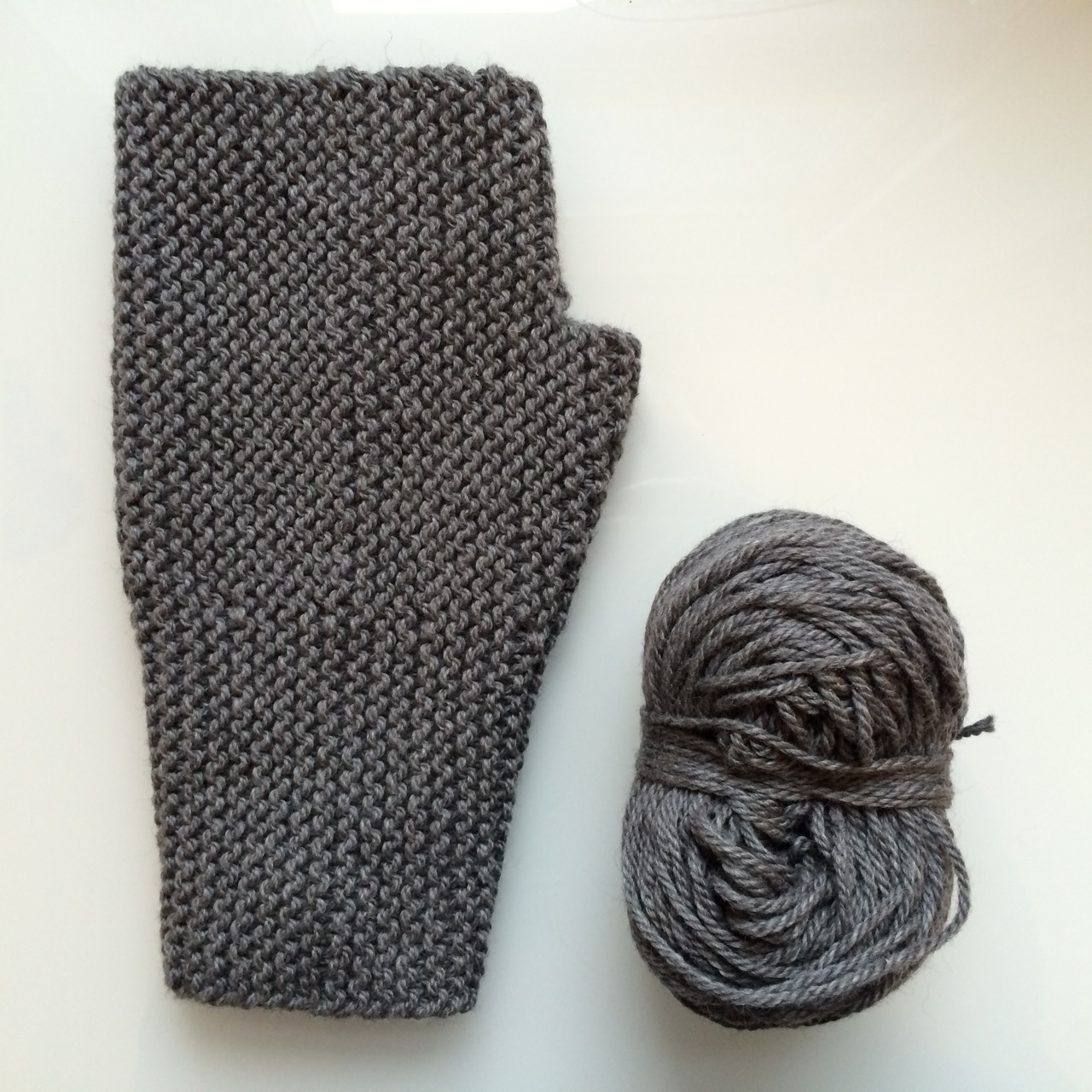 I have exactly 49.5g left of a 100g skein to knit the other mitten. It's going to be close...