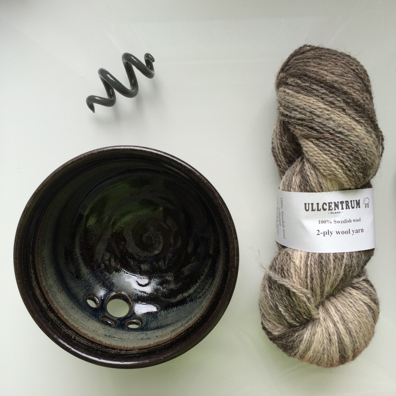 "Why yes, that is a new yarn bowl. And glass spiral shawl pin, and a very restrained single skein of ""non-work"" yarn."