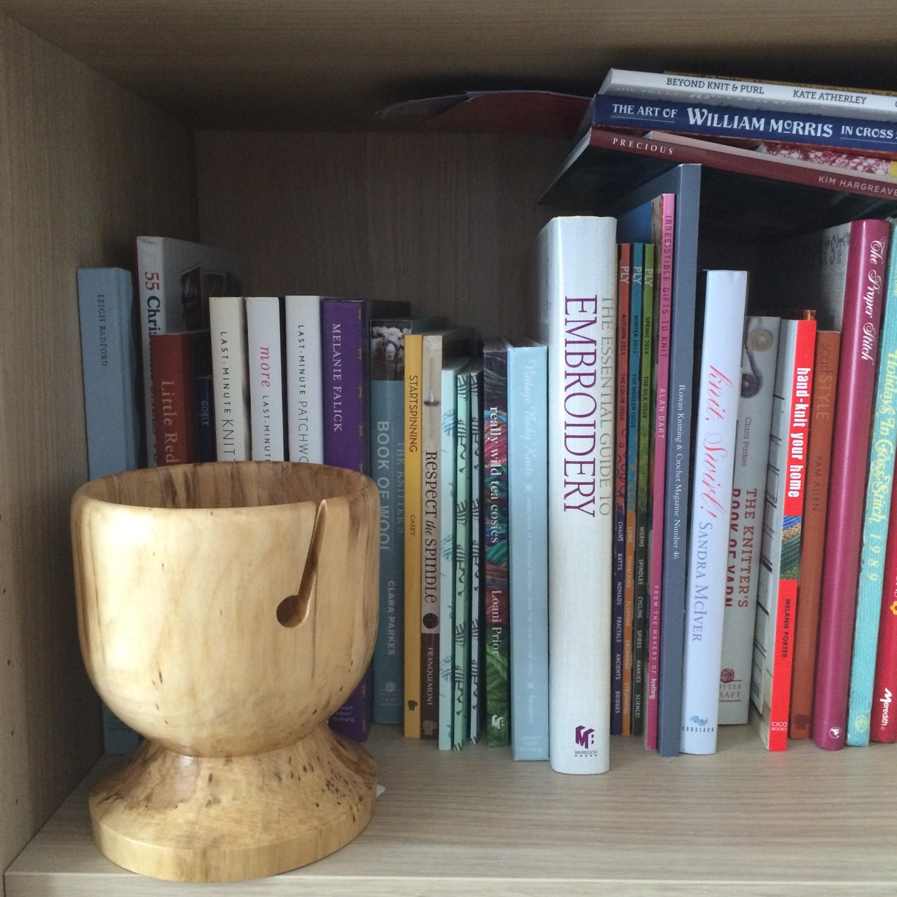 The Wooden Yarn Bowl and his strategic position on the shelf with the knitting books.