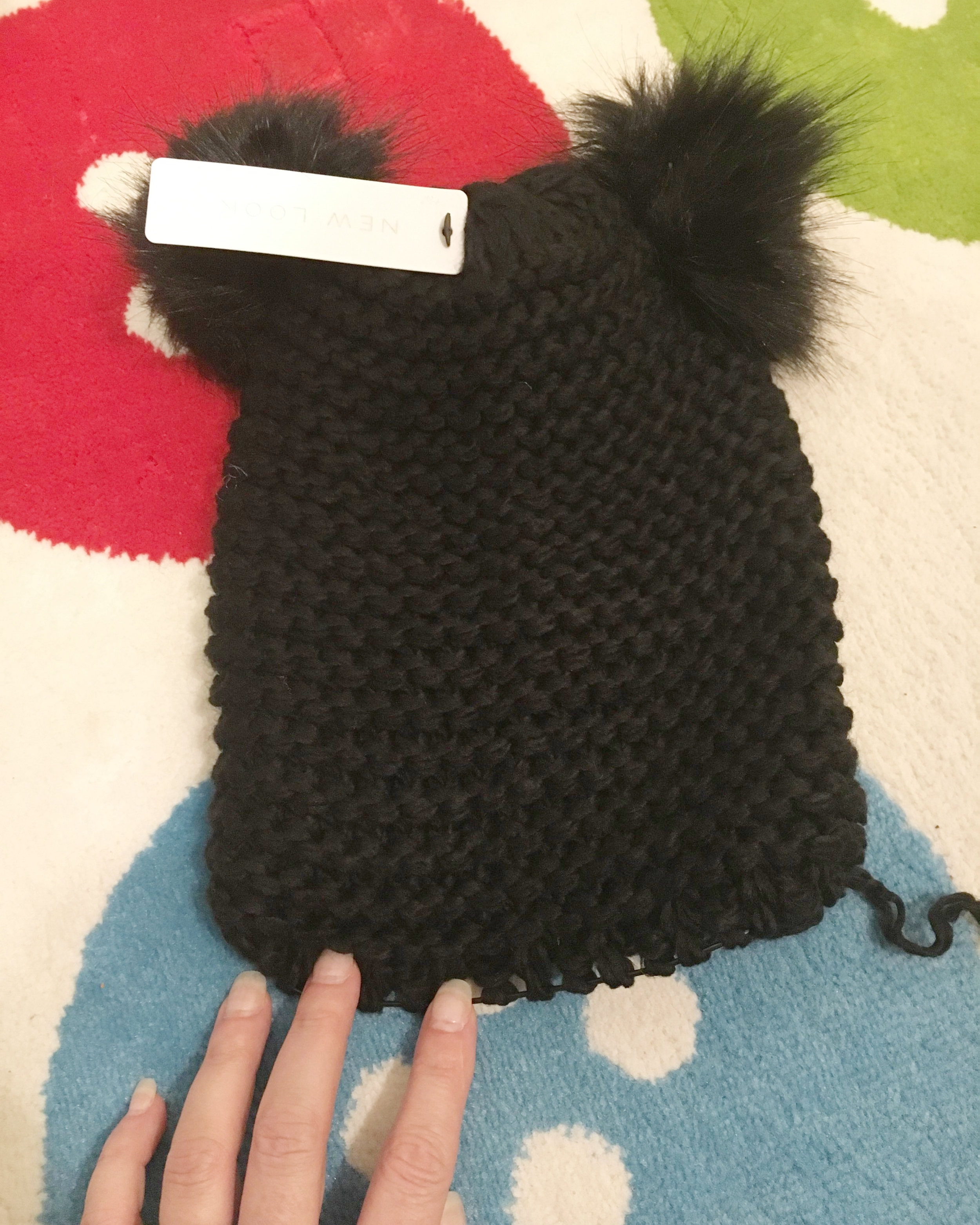 Hat after the brim was unravelled. Cute, but a little unfinished looking now. And man photographing black yarn is hard!