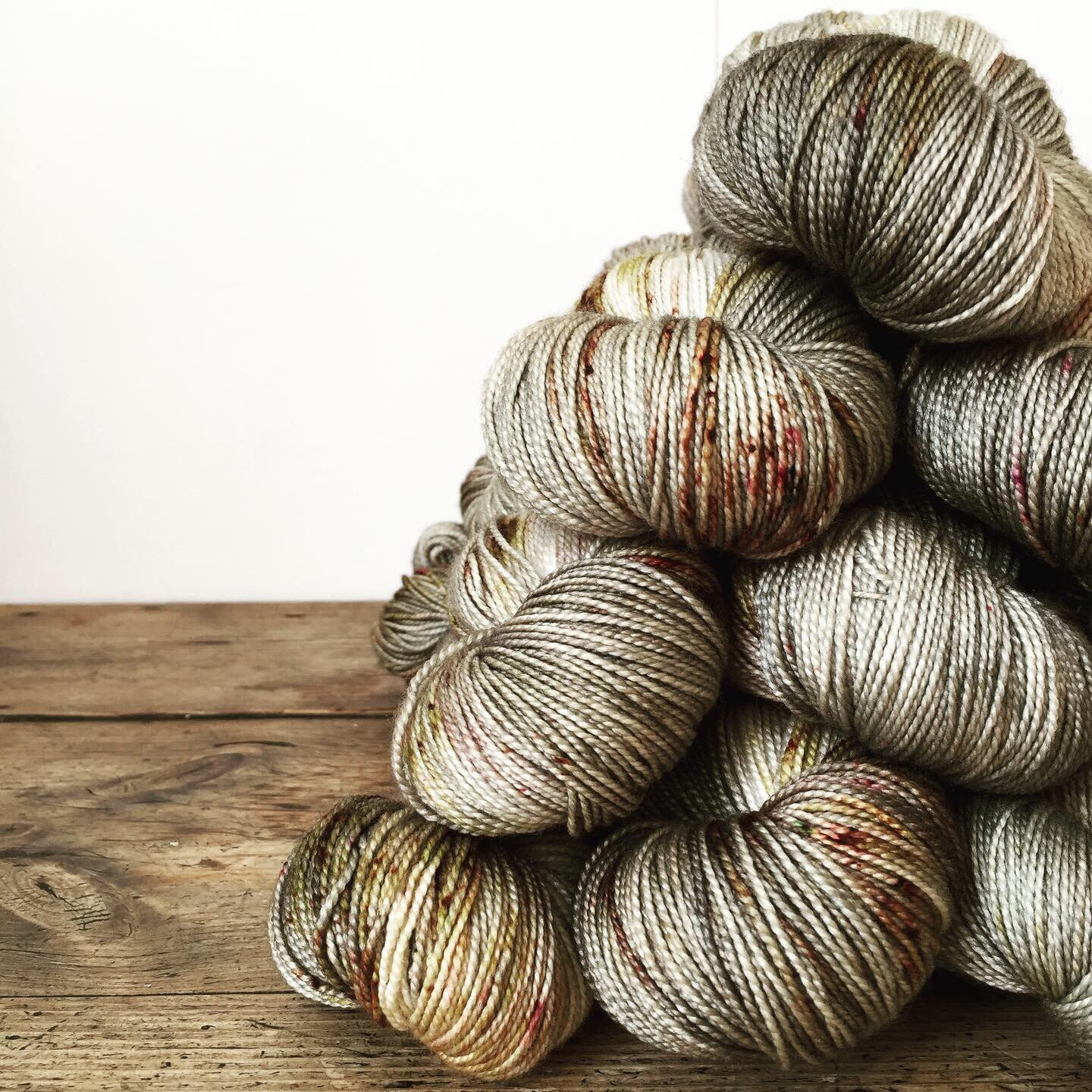 Lux Hi Twist in Rune Stone, a warm greenish grey with dark gold and burgundy speckles by The Urban Purl