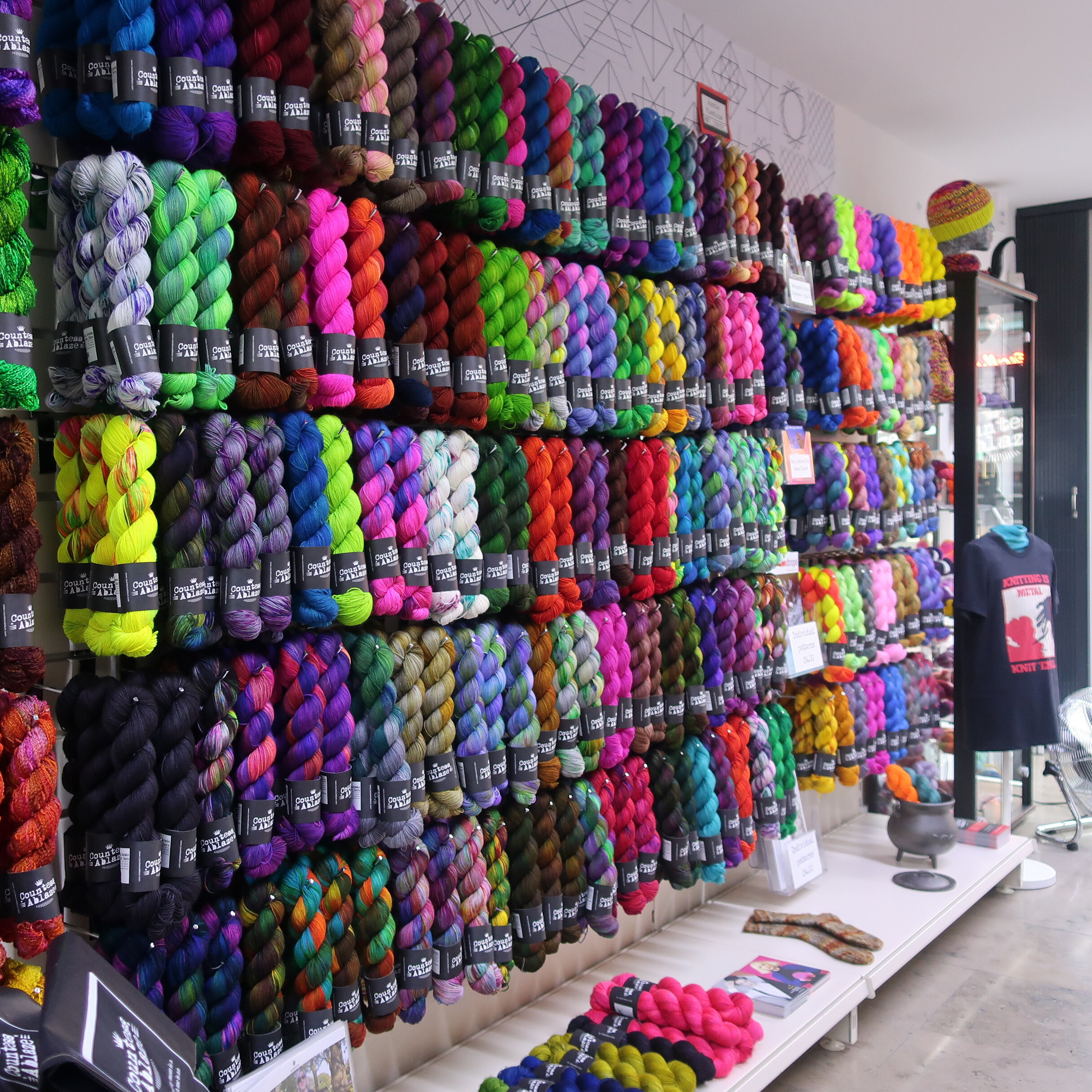 The great wall of 4ply on the fingering floor at Countess Ablaze's shop in Manchester