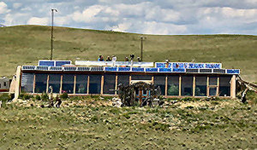 The LeDue off-grid earthship in the mountains near Como, Colorado featuring a wide array of south facing windows.
