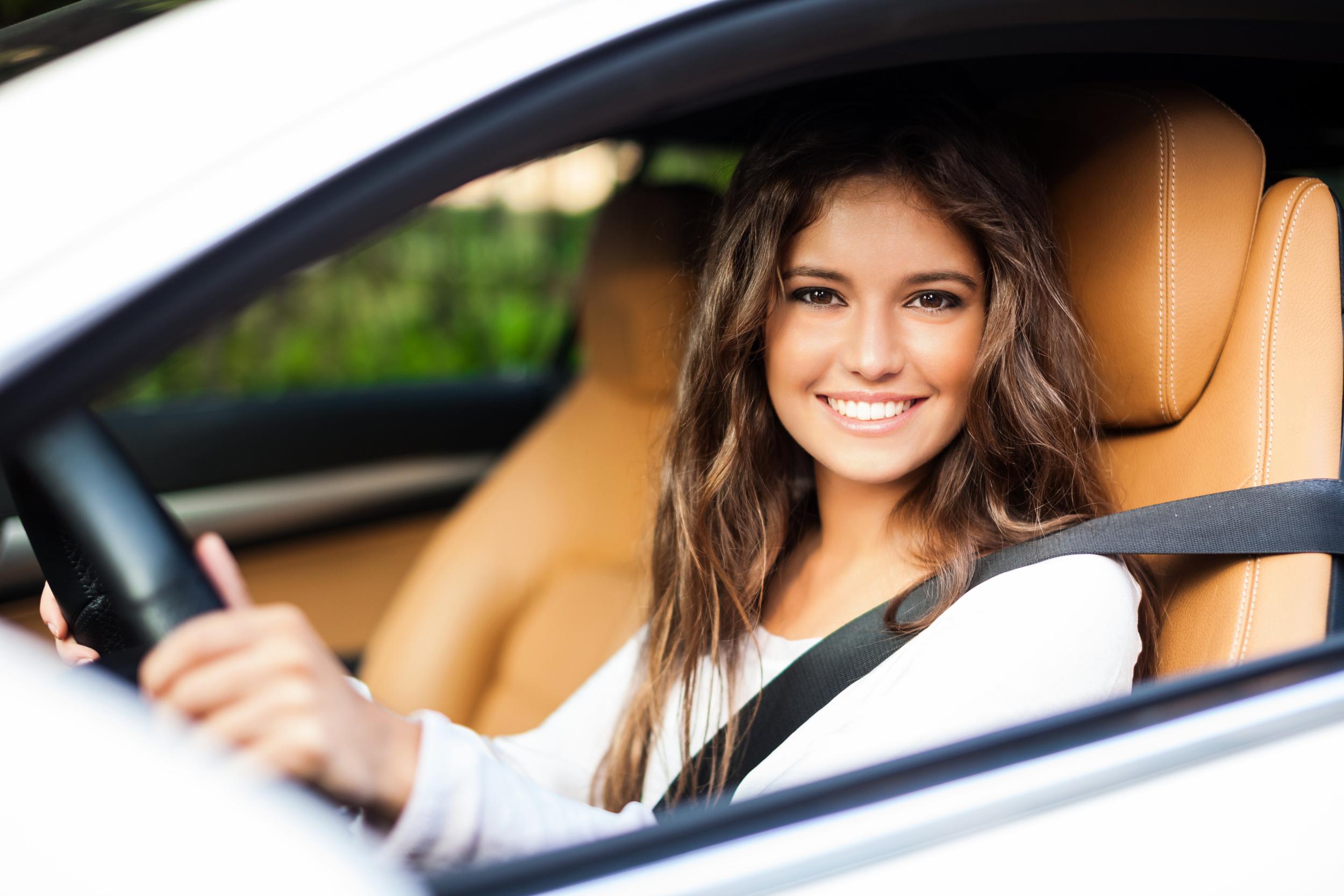 bigstock-Young-woman-driving-her-car-77893382.jpg