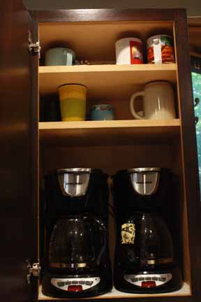 Again - we were really tired of having STUFF take up all our counter space, so we put the coffee makers in the cabinet. Yep - they are plugged in and functional, so you can open the cabinet, grab a mug and choose decaf or regular! Genius...