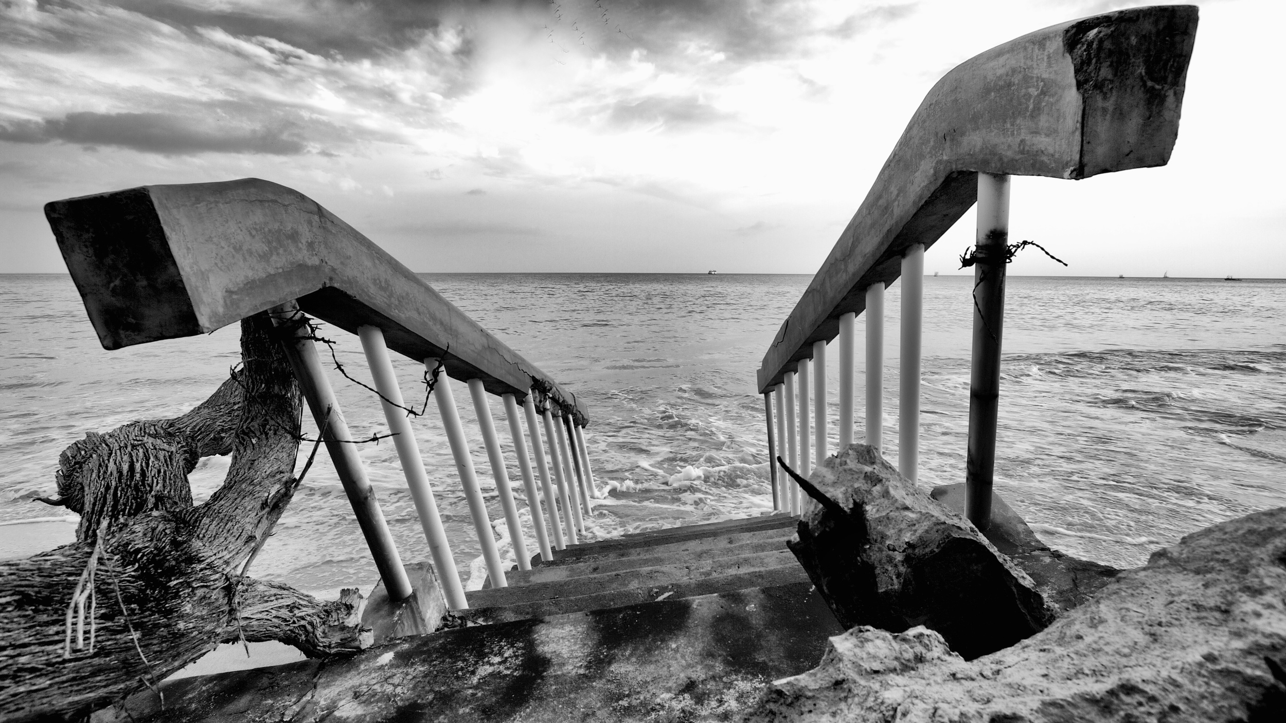 A lonely set of stairs leads into the water.  Canon EOS 7D EF-S 10-22mm at 10mm f/7.1 1/160 ISO 100