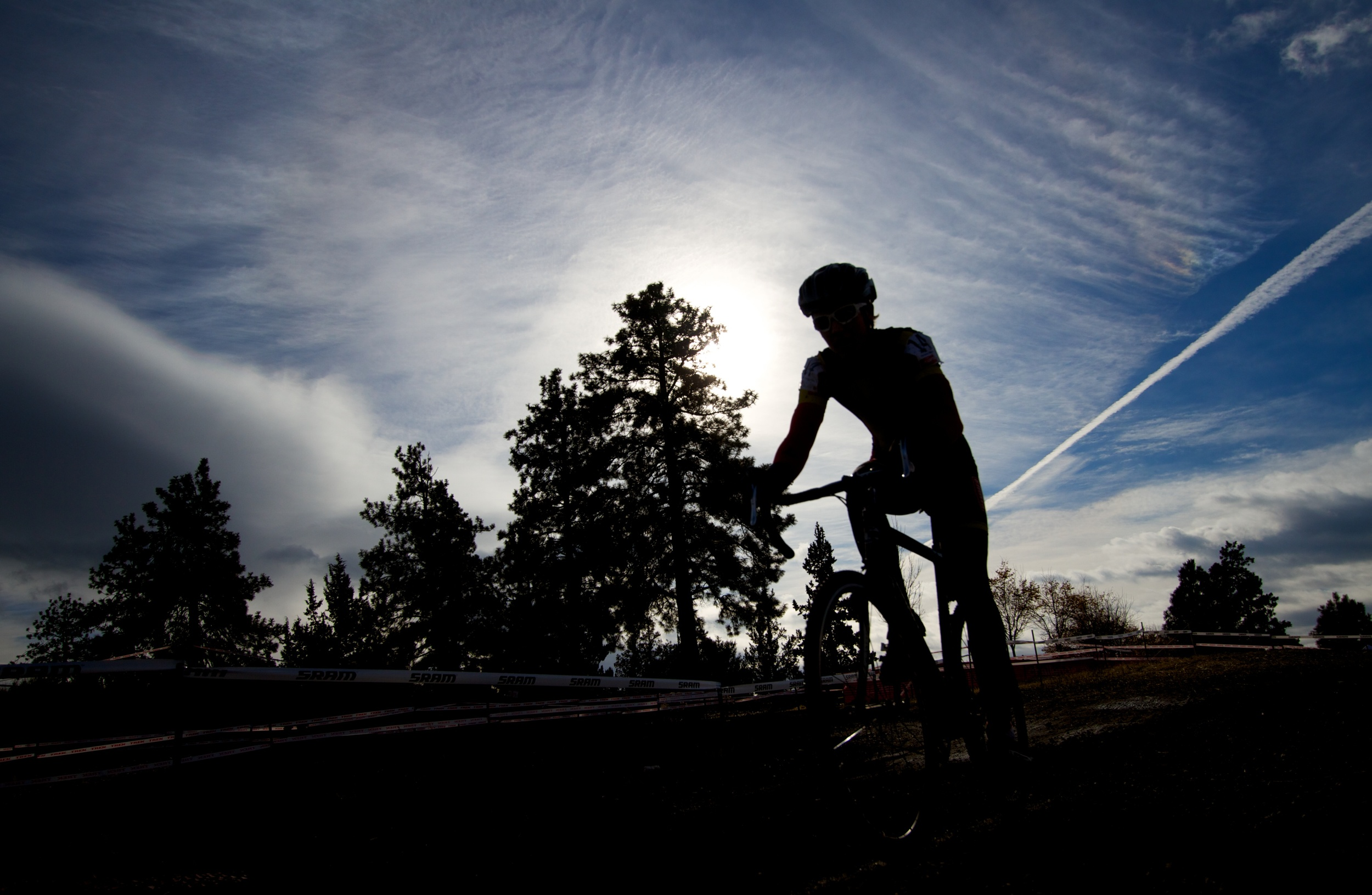 The silhouette of a cyclocross racer as he powers on through the race.  Canon EOS 7D EF-S 10-22mm at 17mm f/4 1/500 ISO 100 −1ev