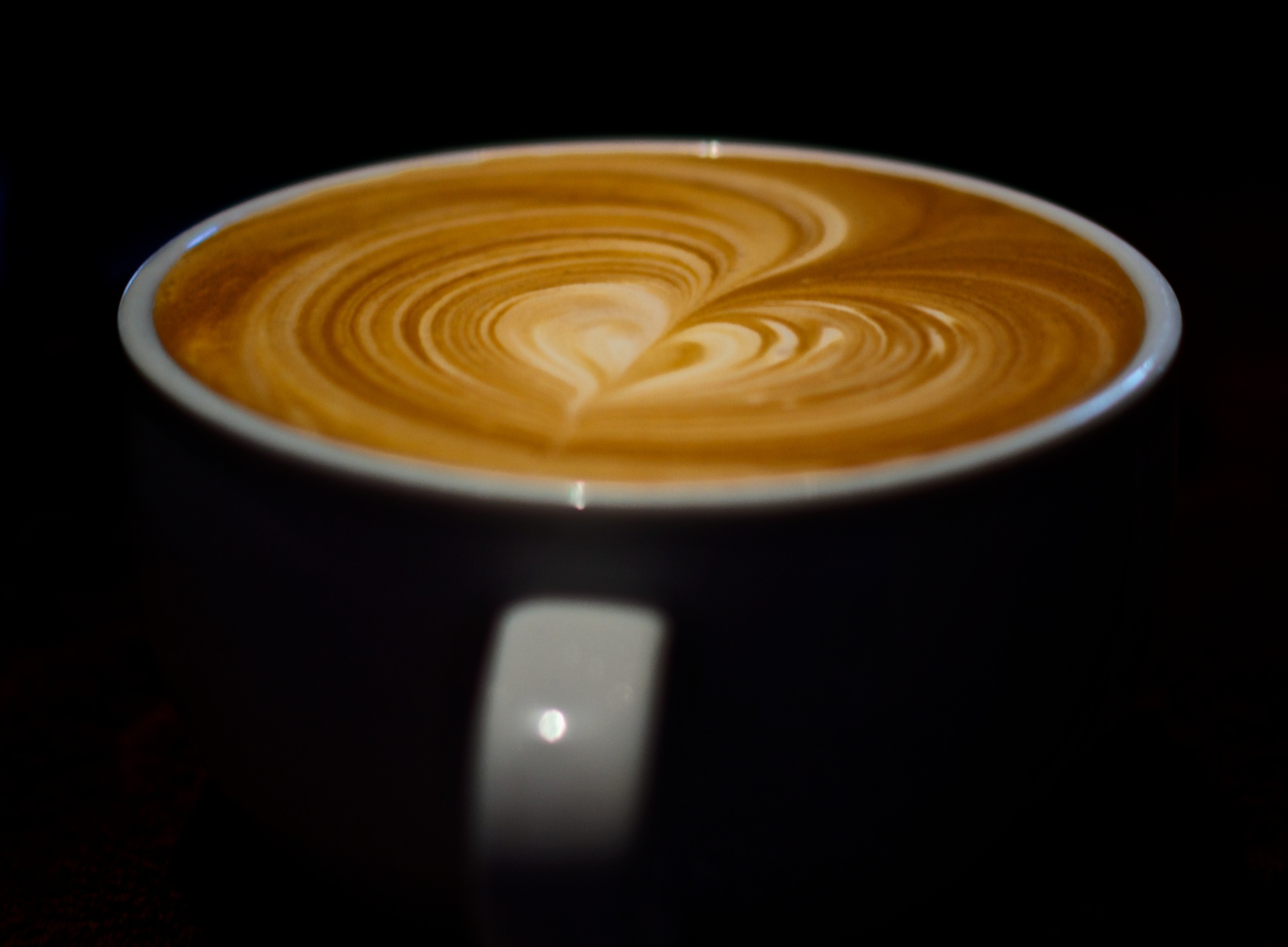 A beautiful pour of espresso floats ethereal in the darkness. Canon EOS 7D EF 50mm at f/2.2 1/100 ISO 100