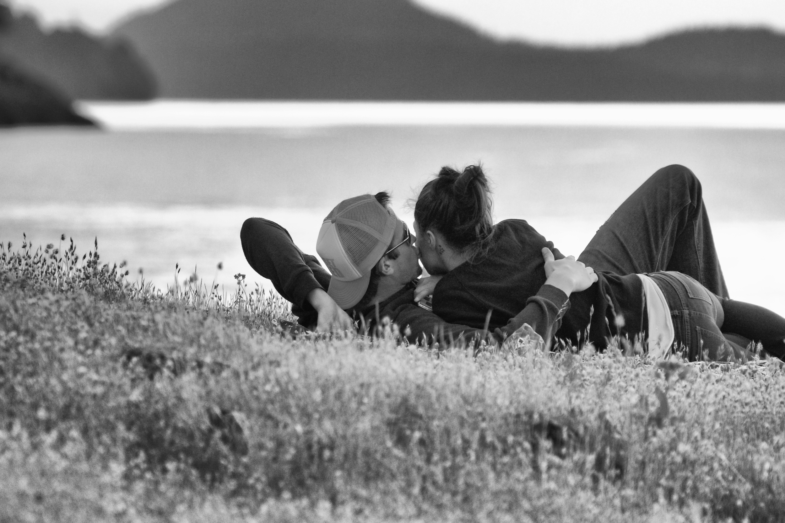 Young lovers share kiss in the sunset. Canon EOS 7D EF 70-300mm at 207mm f/5.6 1/250 ISO 3200