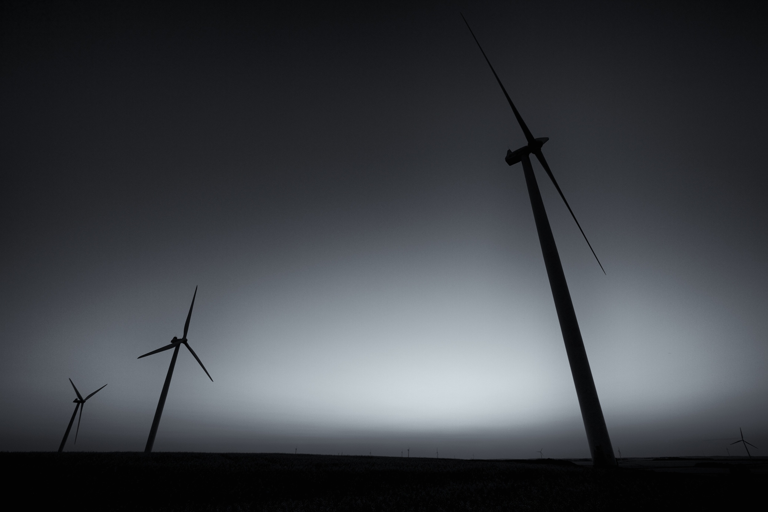 Tilting windmills reach into a darkening sky. Canon EOS 7D EF-S 10-22mm at 10mm f/5.6 1/100 ISO 100