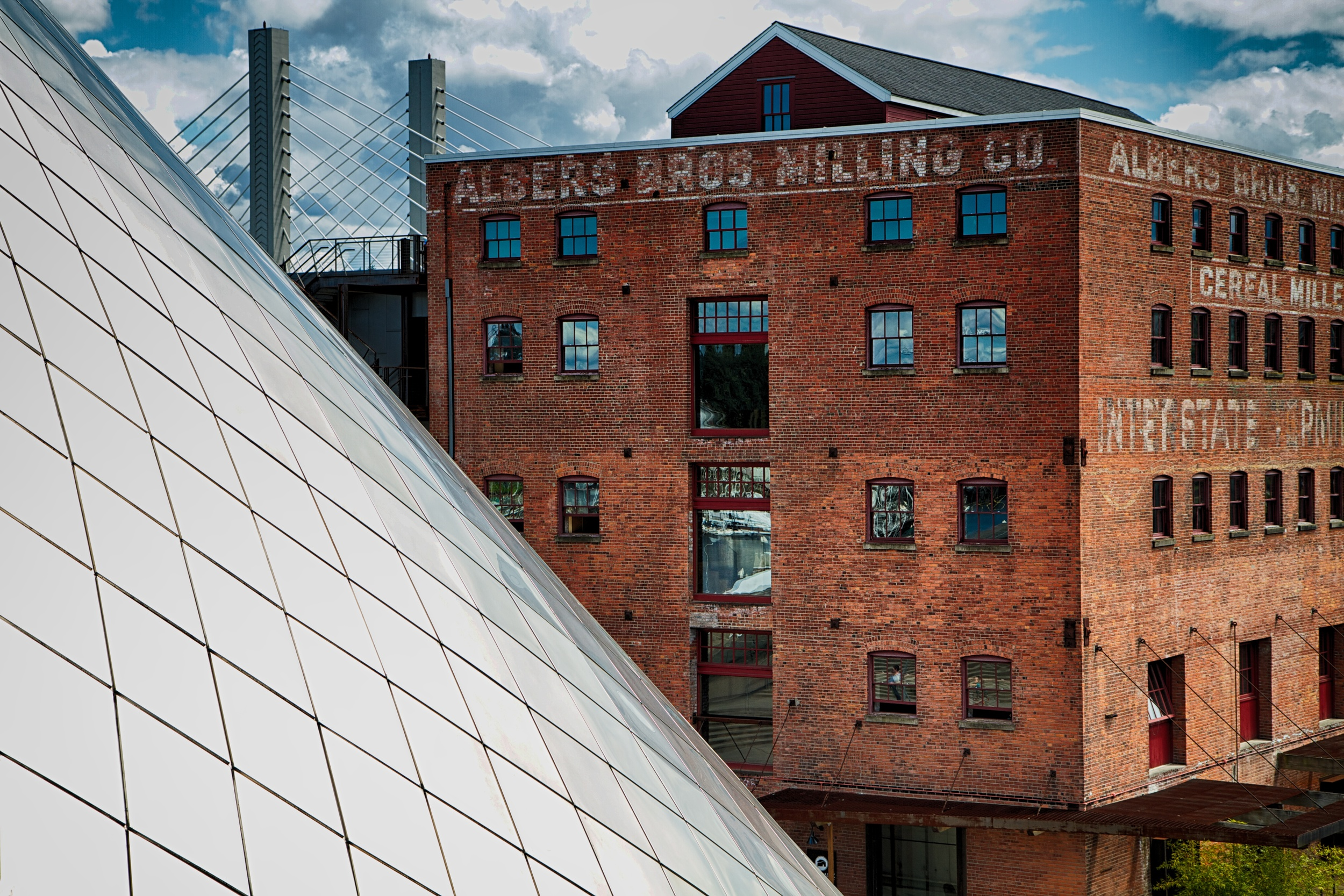 The conical shape of The Glass Museum in Tacoma stands in contrast to the old brick warehouse.  Canon EOS 7D EF-S 17-55mm f/2.8 at 42mm f/4.5 1/400 ISO 100
