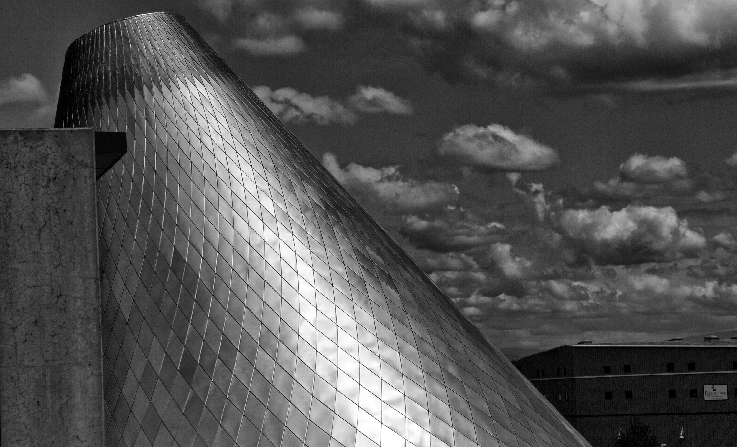 The Glass Museum in Tacoma rises as a stainless steel cone against the clouds in the sky.  Canon EOS 7D EF-S 17-55mm f/2.8 at 55mm f/10 1/4000 ISO 100 -1ev