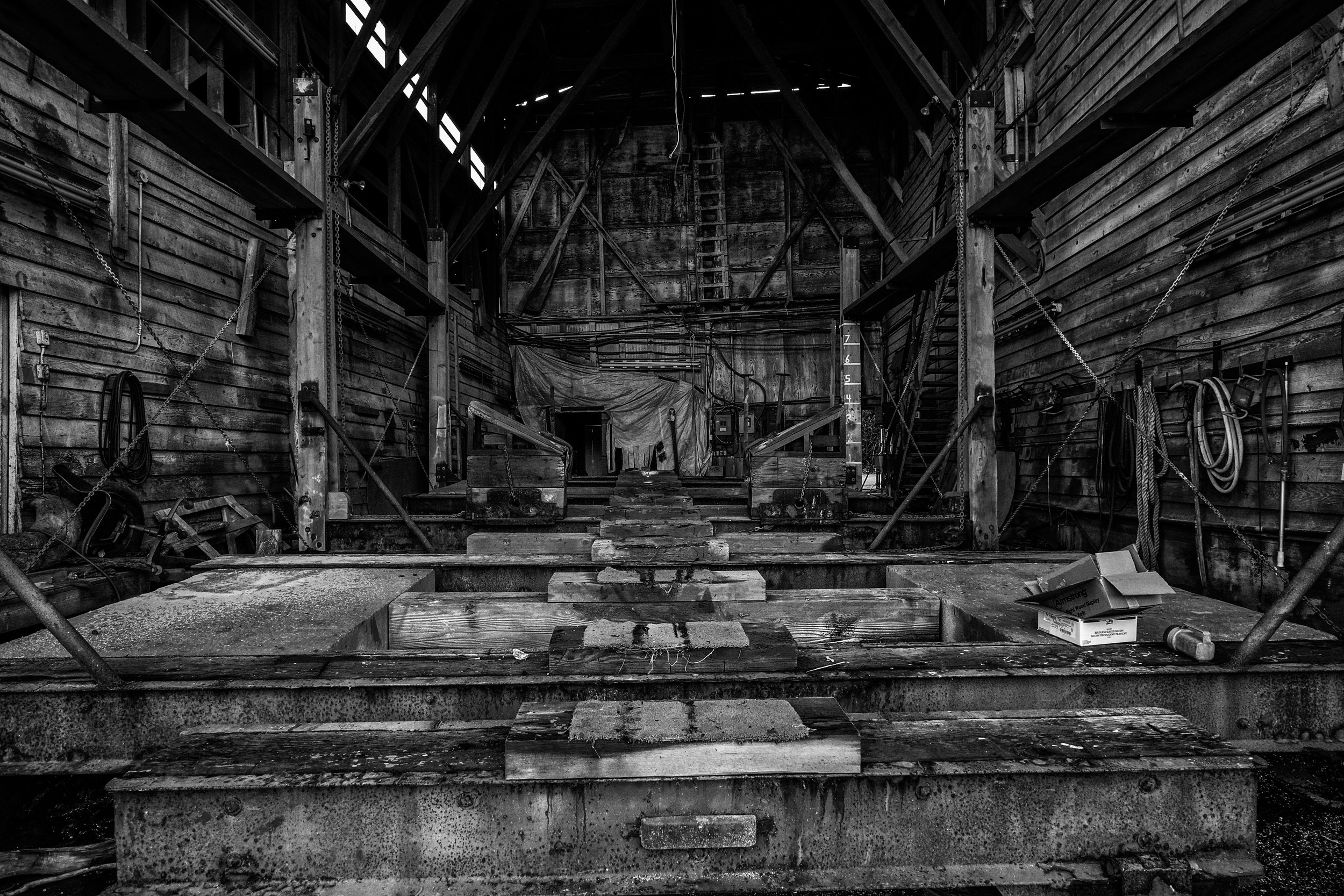 The shadowy interior of a dry dock invites further exploration.  Fuji X10 DF14mm f/2.8 at f/8 1/30 ISO 2500