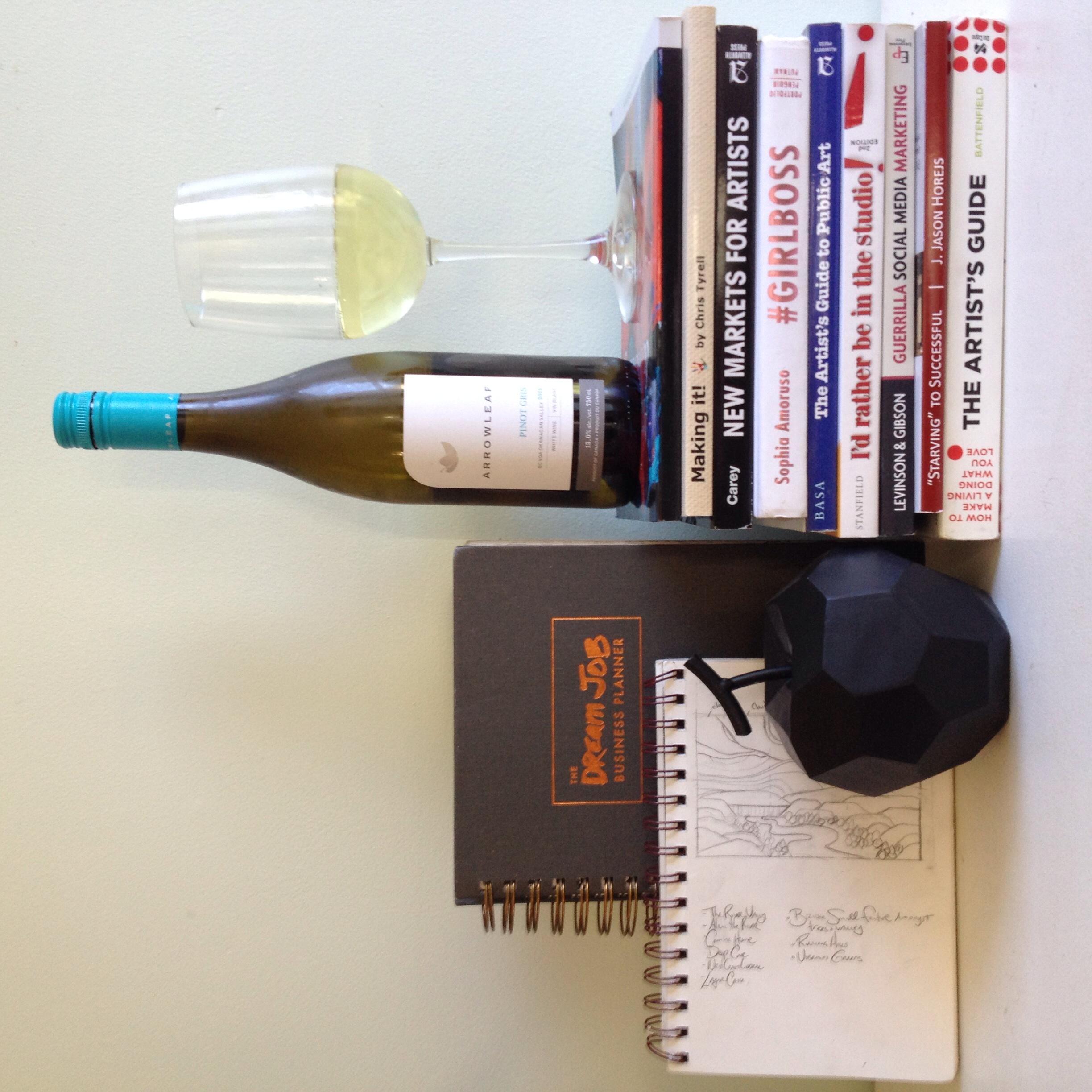 All of my art business books, my favourite Arrowleaf wine, my  Dream Job Business Planner  and my trusty sketchbook.