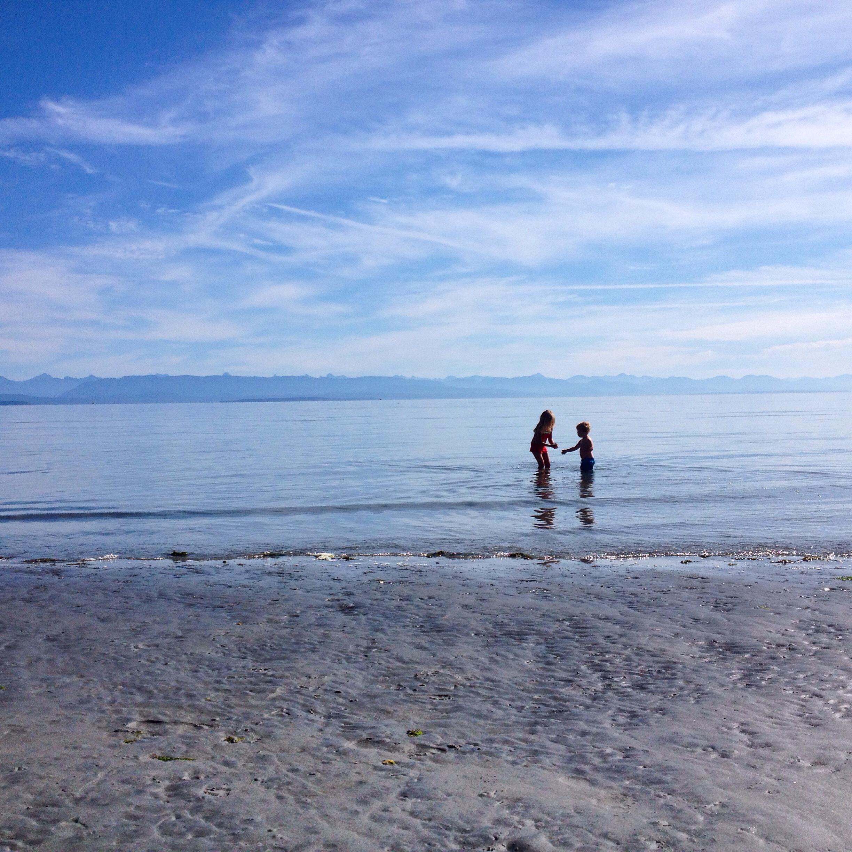 Joni and Jack playing with Sanddollars at Saratoga Beach
