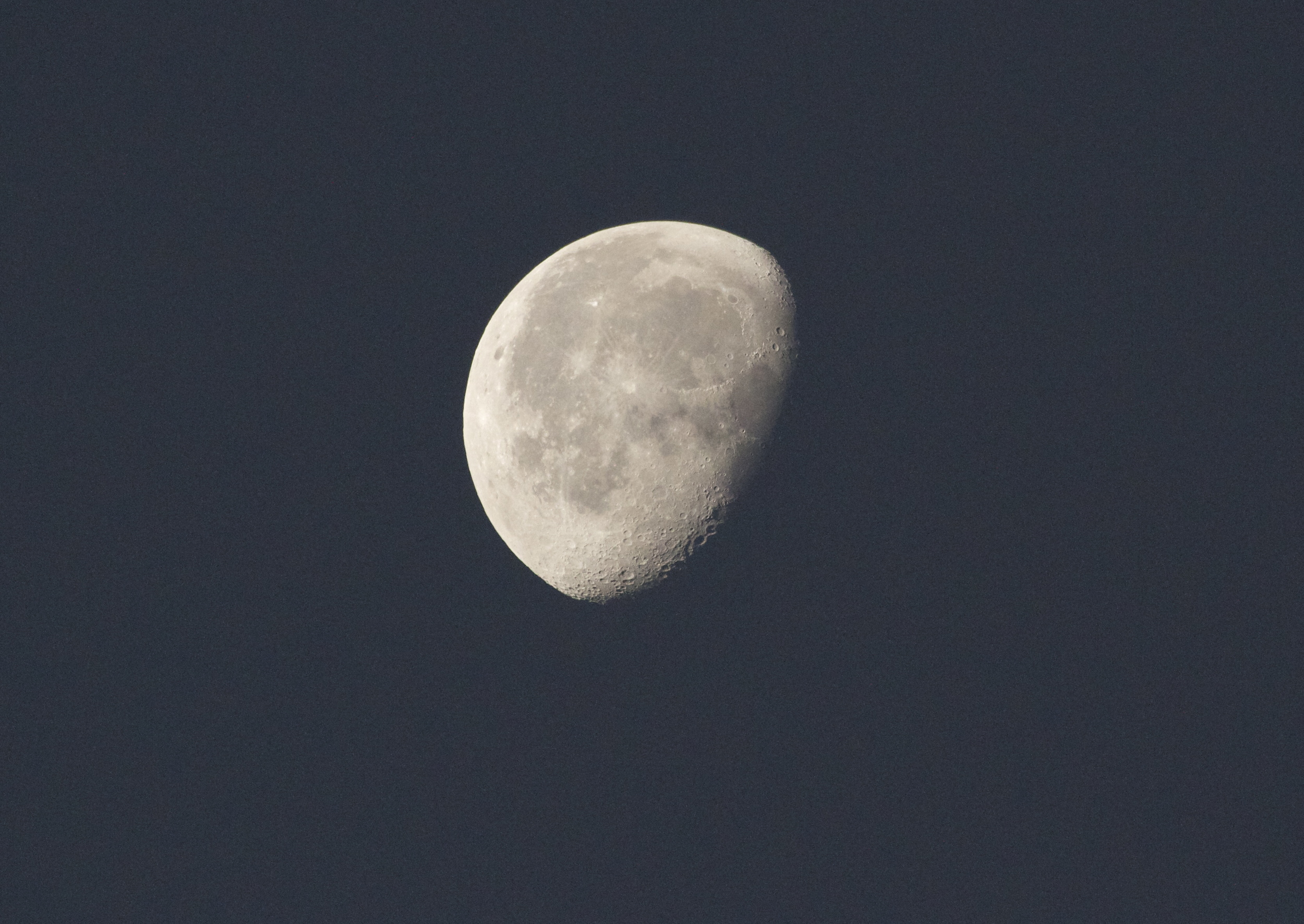 Beautiful predawn waning moon with craters visible lower right,