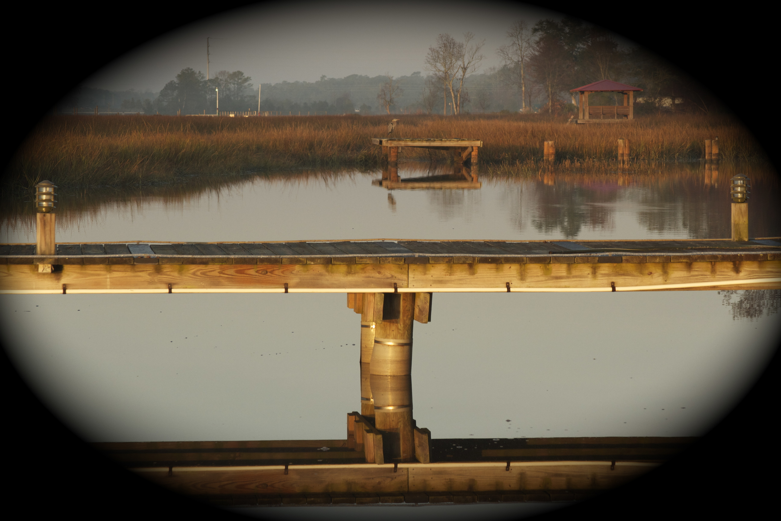 The Golden Glow arrives and is reflected on the marsh. Old Man River waits as usual.