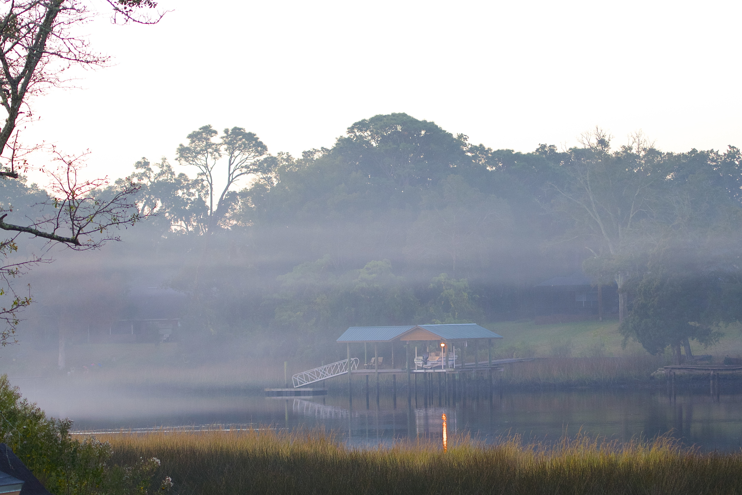 A smoke like layer of fog rises over the water this winter morning on the Broward.