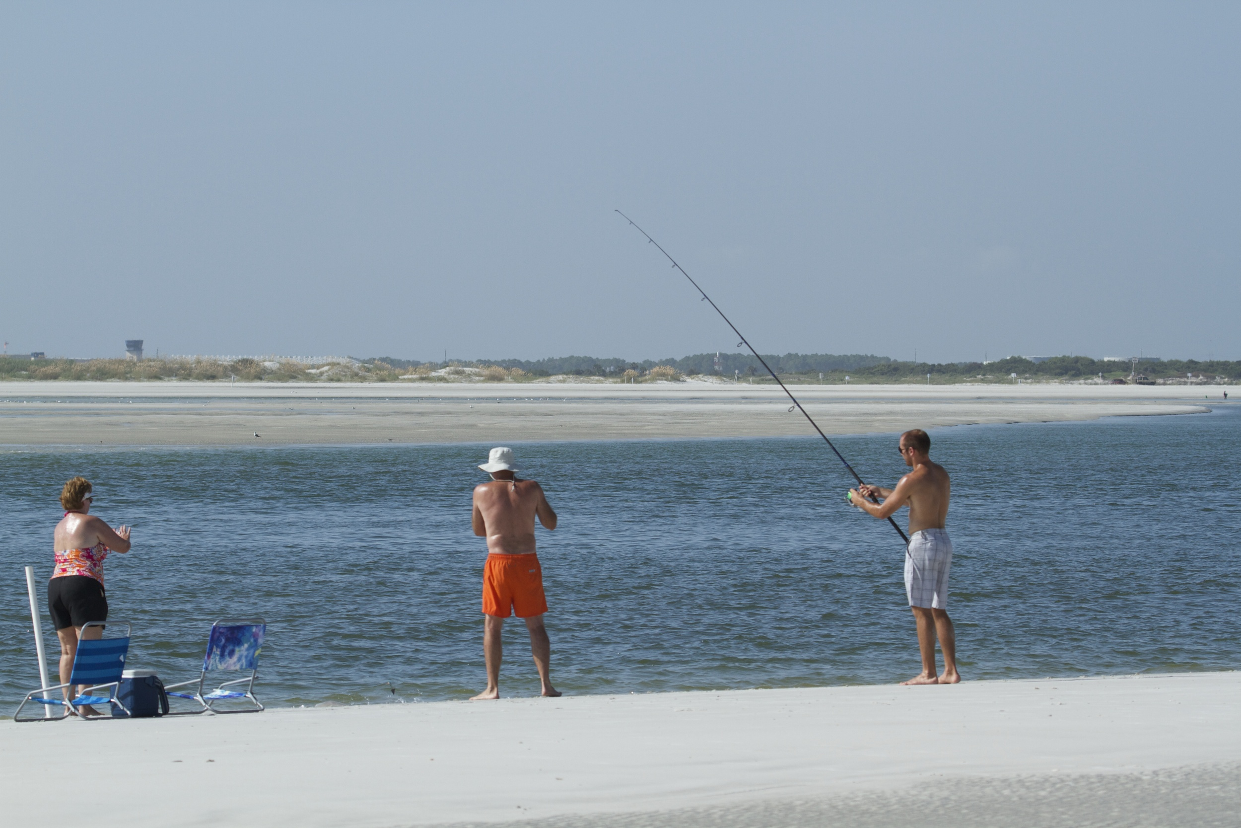 An Ohio family enjoys some surf fishing..they were the only other two legged creatures I saw on the beach.