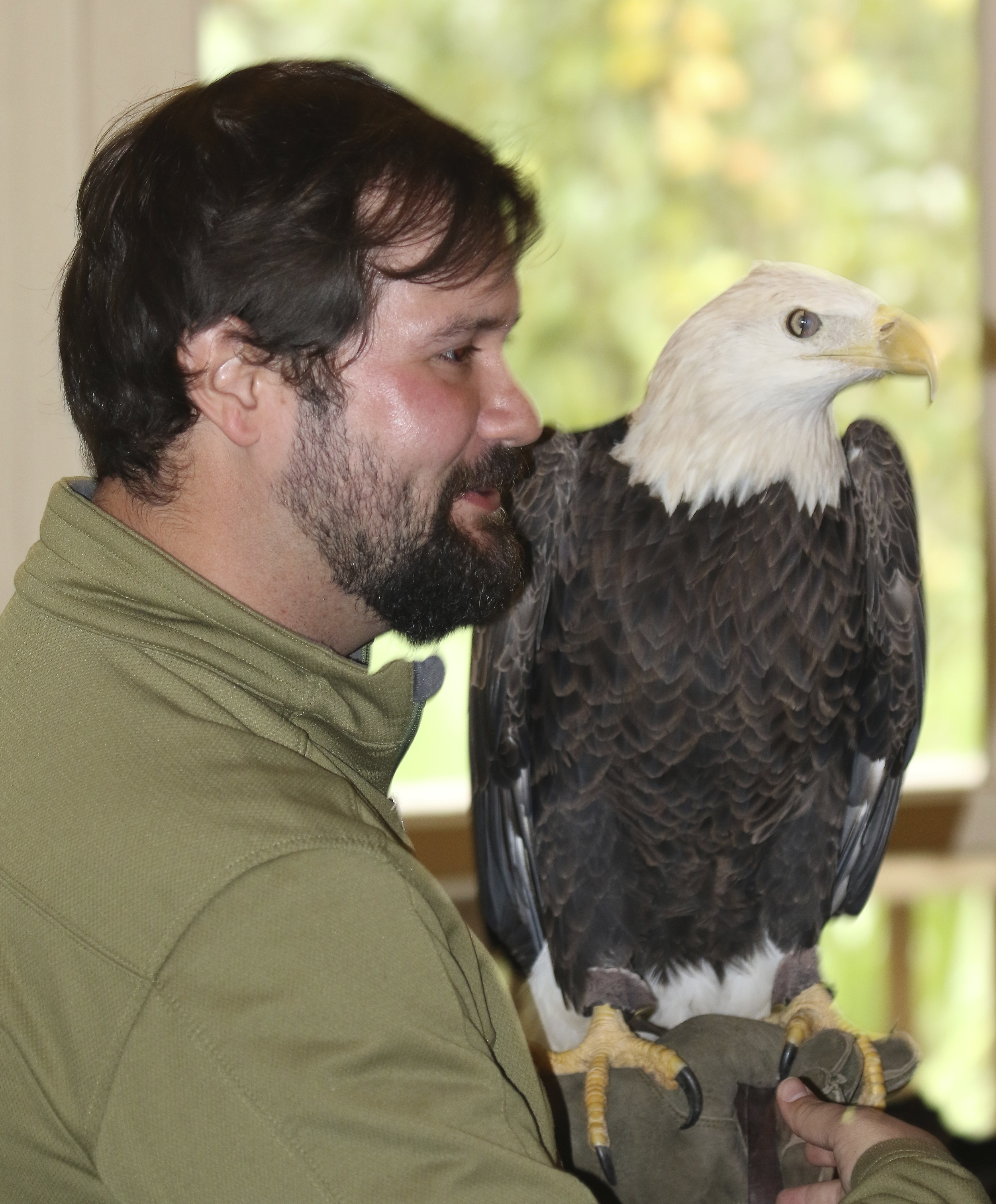 Meet Matt Smith (left) and Francis, a male Bald Eagle at the Audubon Center for Birds of Prey. Note the large talons of the feet on Francis.
